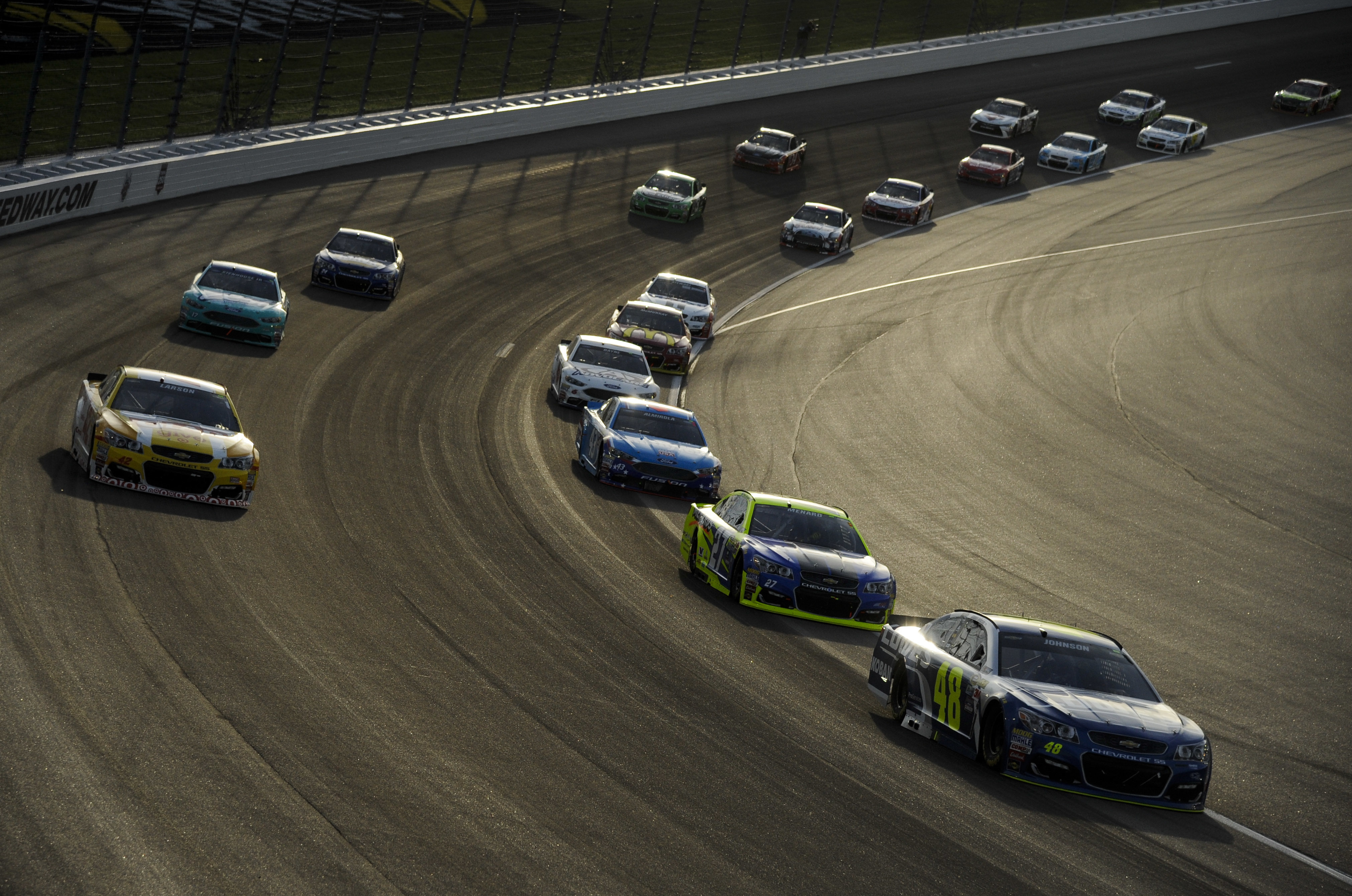 Jimmie Johnson (48) leads a group into the first corner during a NASCAR Sprint Cup Series auto race at Kansas Speedway in Kansas City, Kan., Saturday, May 7, 2016. (AP Photo/Reed Hoffmann)