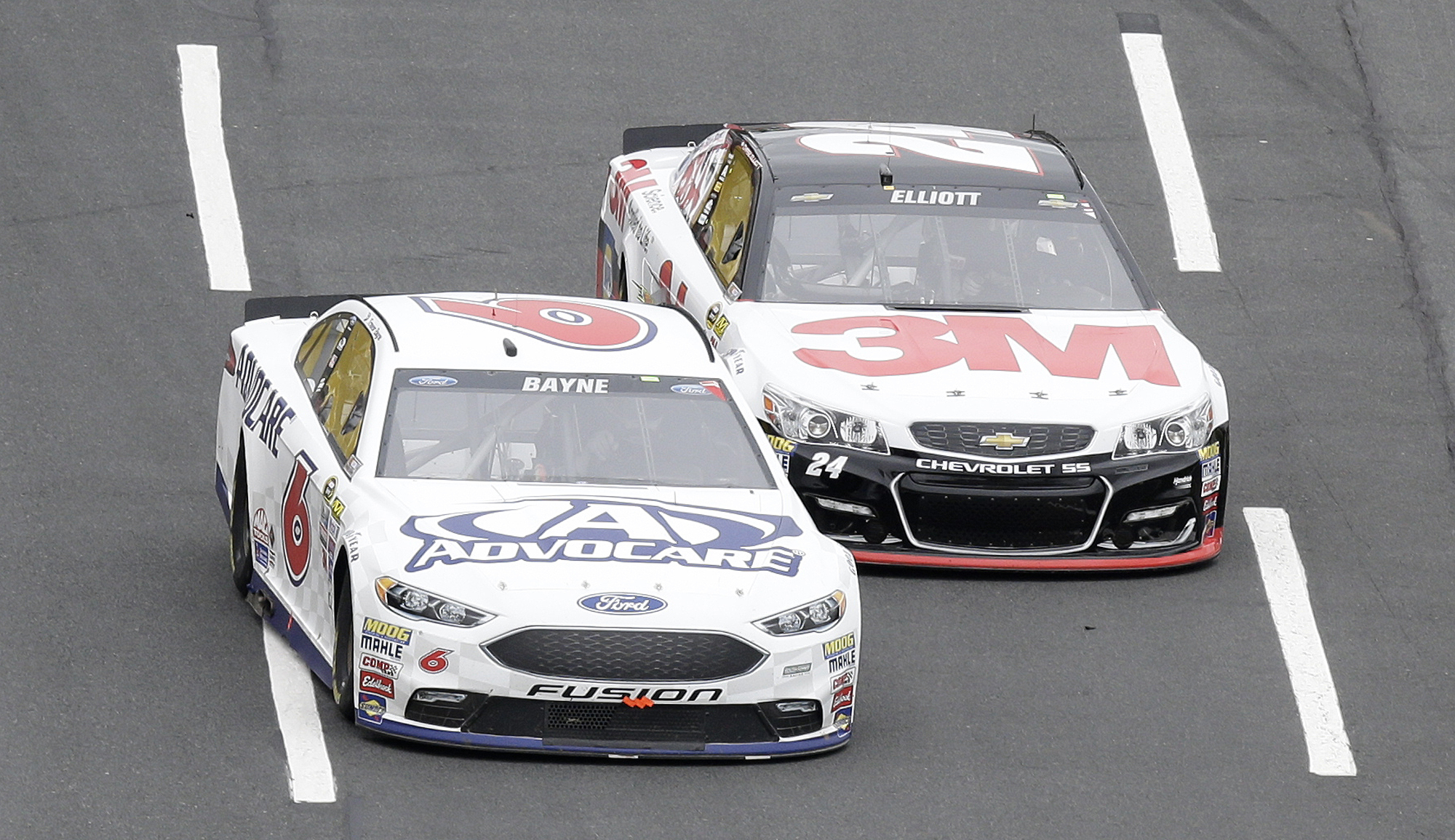 CORRECTS DATE - Trevor Bayne (6) and Chase Elliott (24) race during the NASCAR Sprint Cup Series Showdown auto race at the Charlotte Motor Speedway in Concord, N.C., Saturday, May 21, 2016. (AP Photo/Gerry Broome)