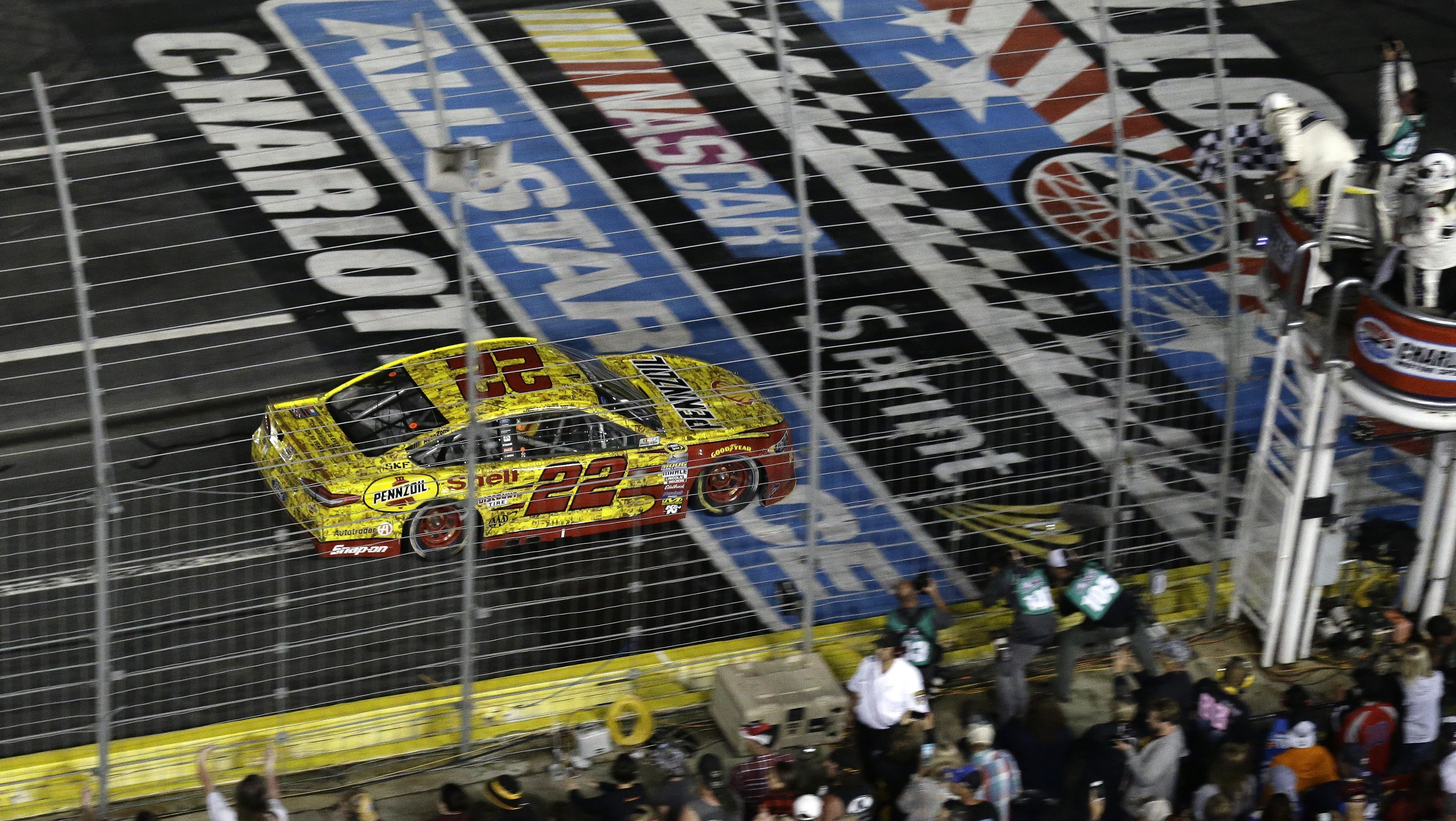 Joey Logano (22) approaches the checkered flag to win the NASCAR Sprint All-Star auto race at Charlotte Motor Speedway in Concord, N.C., Saturday, May 21, 2016. (AP Photo/Gerry Broome)