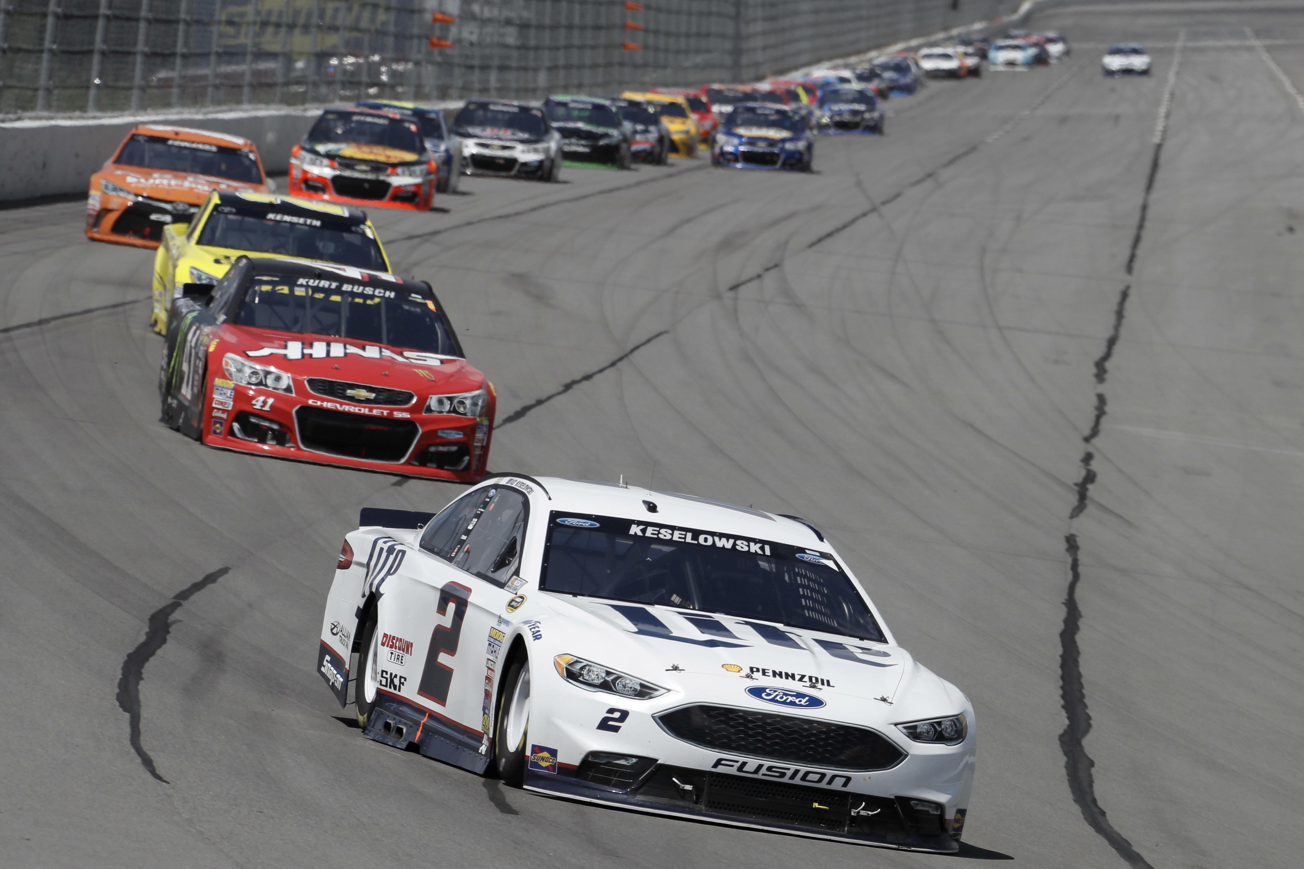 Brad Keselowski drives into Turn 1 during the NASCAR Sprint Cup series auto race at Pocono Raceway, Monday, June 6, 2016, in Long Pond, Pa. (AP Photo/Matt Slocum)