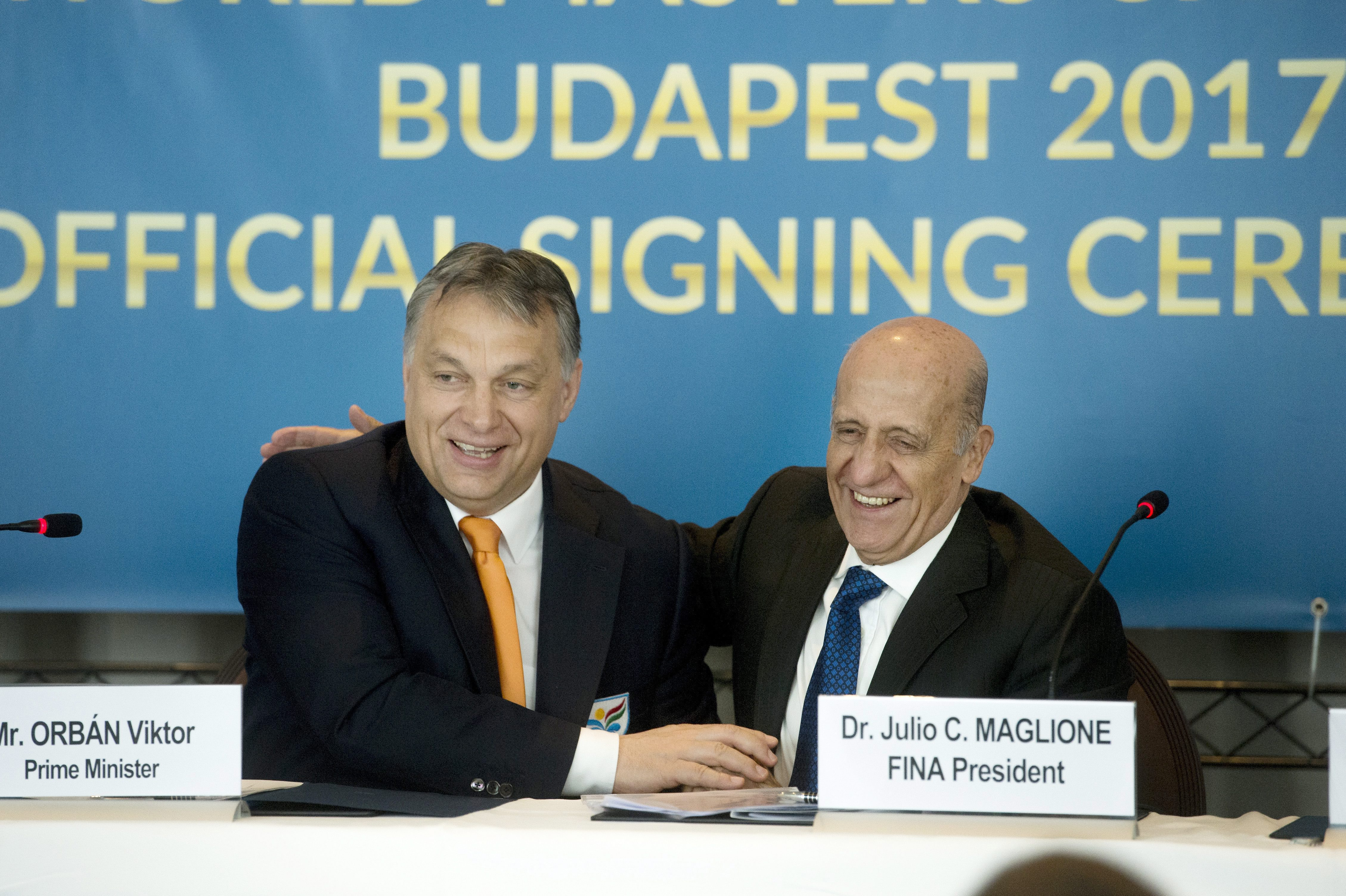 Hungarian Prime Minister Viktor Orban, left, and FINA President Julio C. Maglione smile as they sign an agreement on Budapest's hosting the World Aquatics Championships in 2017 in Hotel Palace in Lausanne, Switzerland, Thursday, April 16, 2015. Budapest r