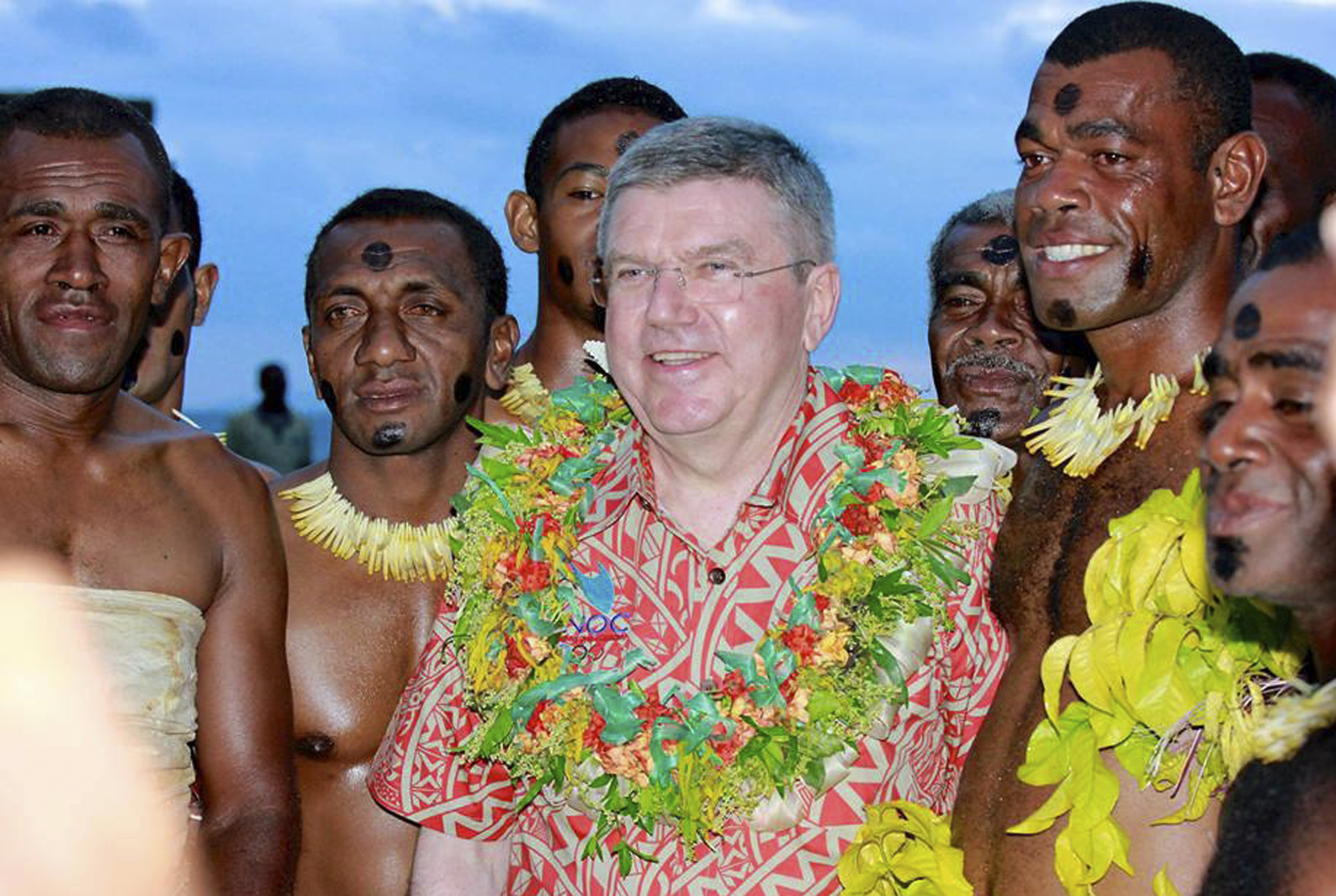 International Olympic Committee President Thomas Bach, center, poses for a photo with local men in Suva, Fiji, Saturday, May 2, 2015. Bach, addressing the Oceania National Olympic Committee meeting, has urged national and regional Olympic bodies to lobby