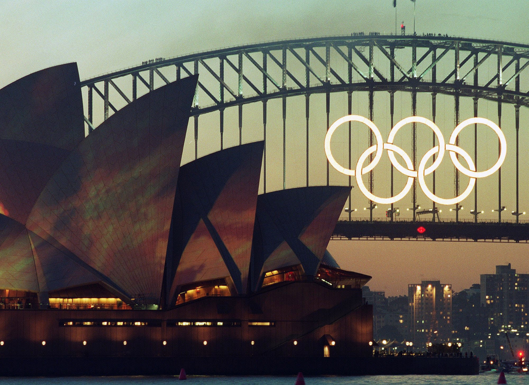 FILE - In this Sept. 14, 2000 file photo the Olympic Rings glow on the the Sydney Harbour Bridge the day before the opening of the 2000 Olympic Games in Sydney. The five massive rings from the Sydney Harbour Bridge that were the focal point of celebration