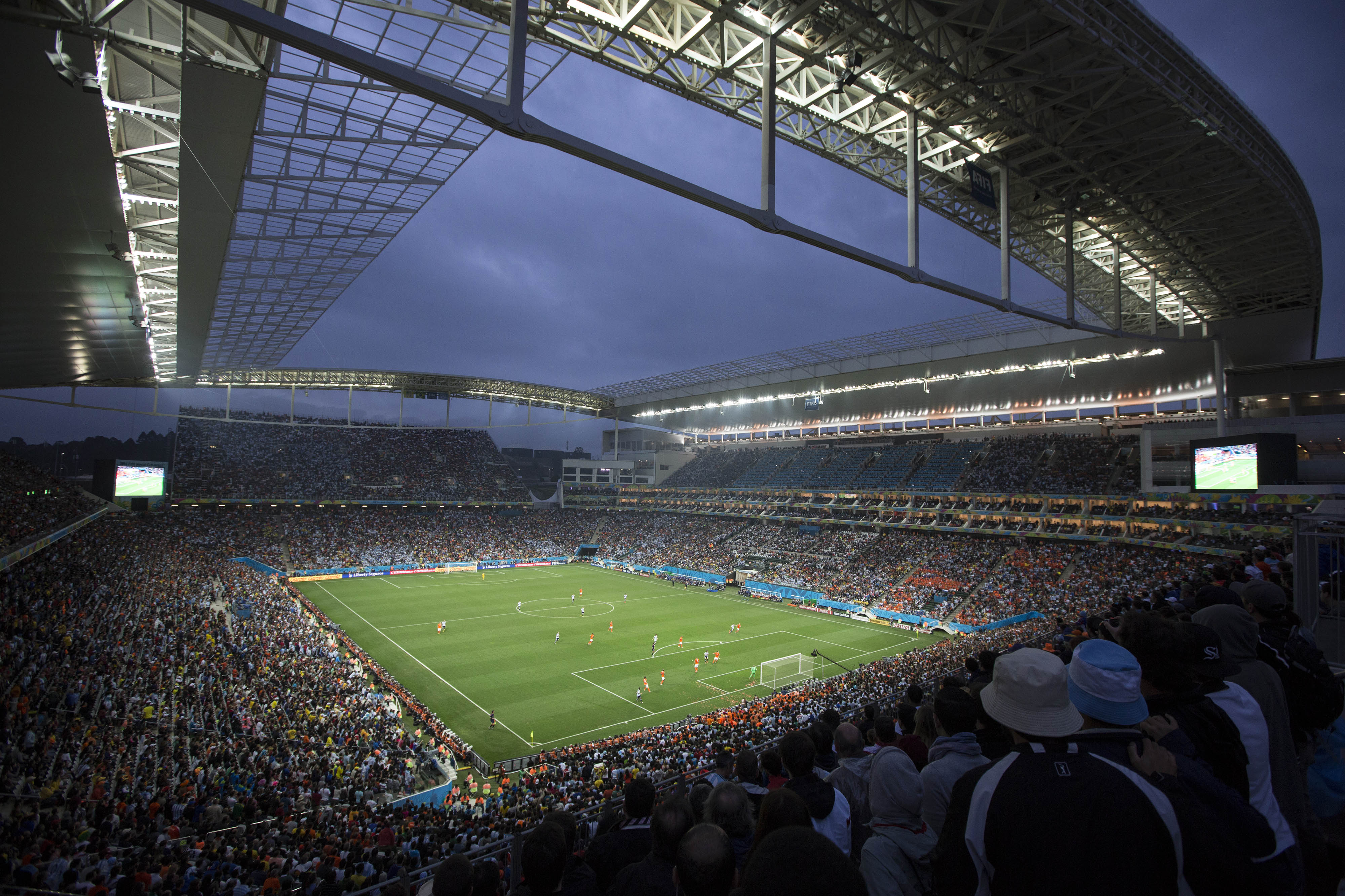 FILE - In this July 9, 2014 file photo, soccer fans watch the World Cup semifinal match between the Netherlands and Argentina in the Itaquerao Stadium, in Sao Paulo Brazil. The 2016 Olympic matches will be held in venues built or renovated for last year's