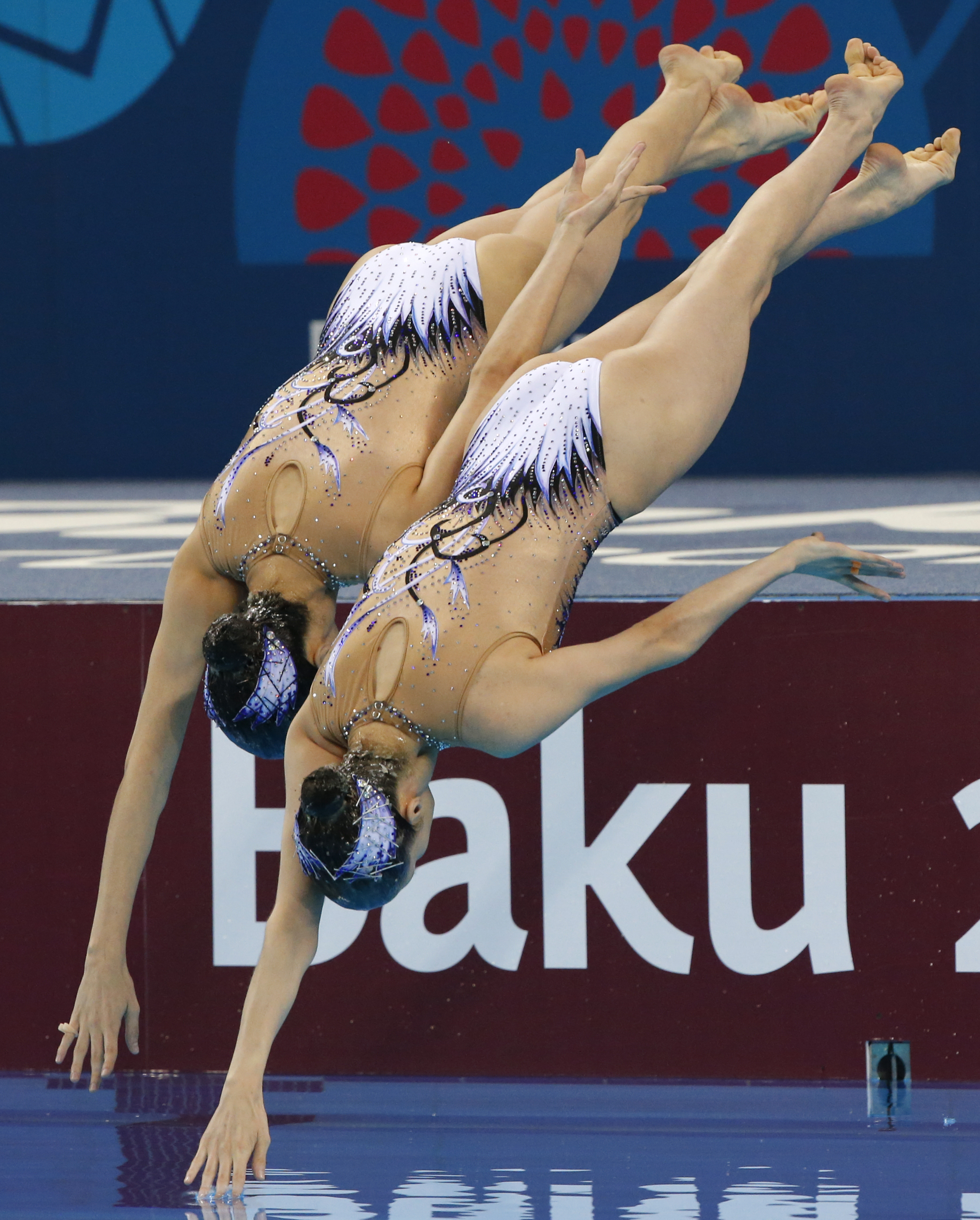 Anna-Maria and Eirini-Marina Alexandri of Austria perform during the final of synchronised swimming, duets event at the 2015 European Games in Baku, Azerbaijan, Monday, June 15, 2015. (AP Photo/Dmitry Lovetsky)