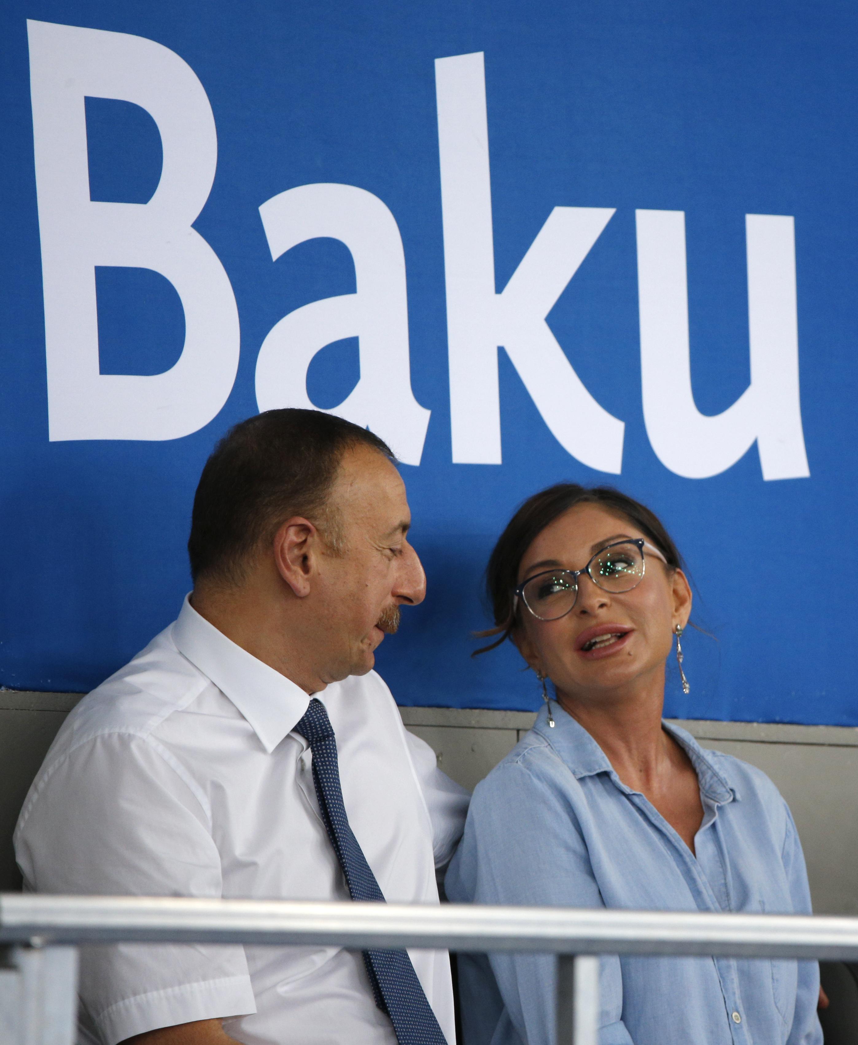 Azerbaijan President Ilham Aliyev and his wife Mehriban Aliyeva attend a taekwondo competition at the 2015 European Games in Baku, Azerbaijan, Thursday, June 18, 2015. (AP Photo/Dmitry Lovetsky)