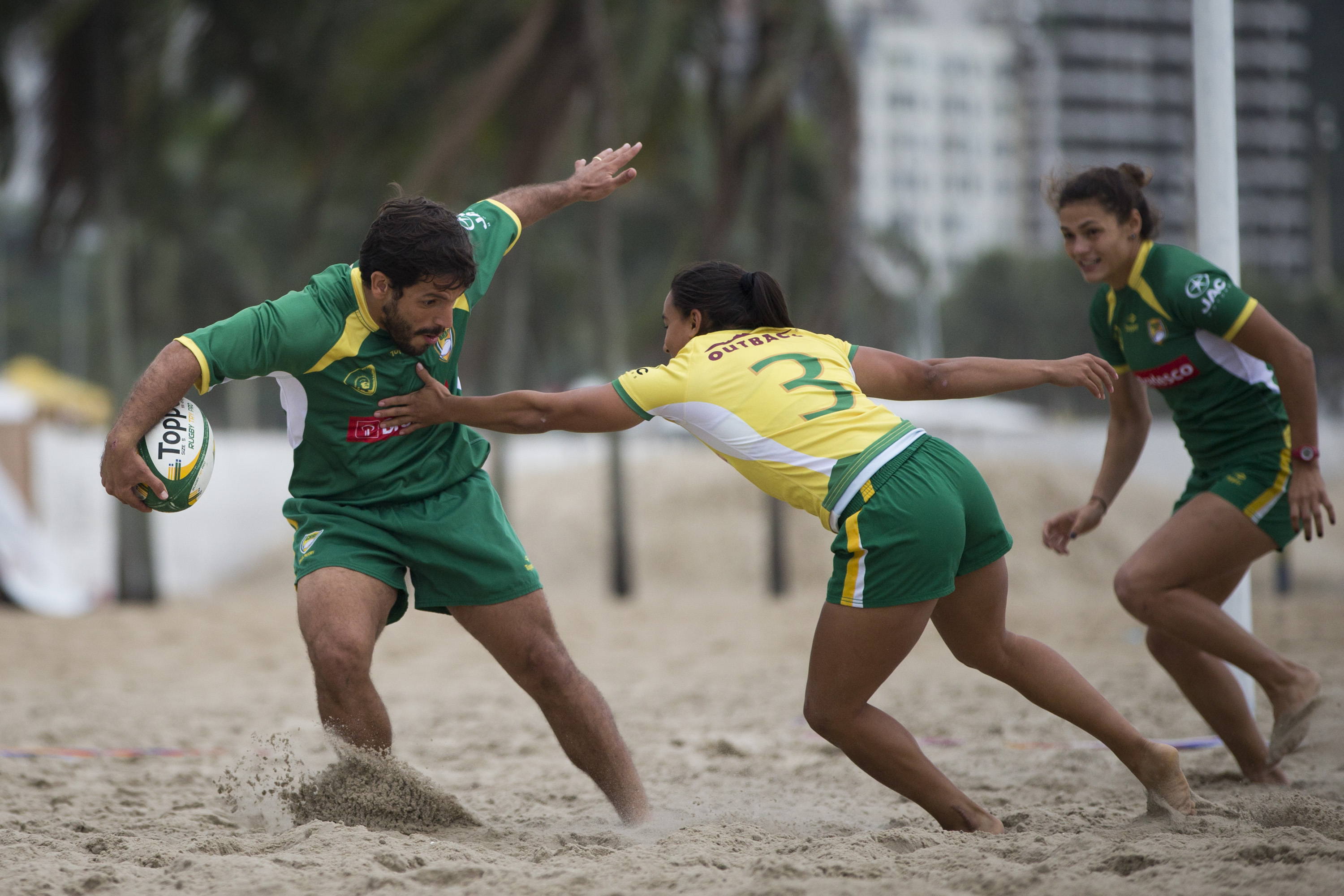 Brazilian athletes play Rugby in a newly inaugurated Rugby pitch on Copacabana beach in Rio de Janeiro, Brazil, Wednesday, June 24, 2015. The pitch will be a long-lasting fixture on Rio's iconic Copacabana beach until the Rio 2016 Olympics, when Rugby wil