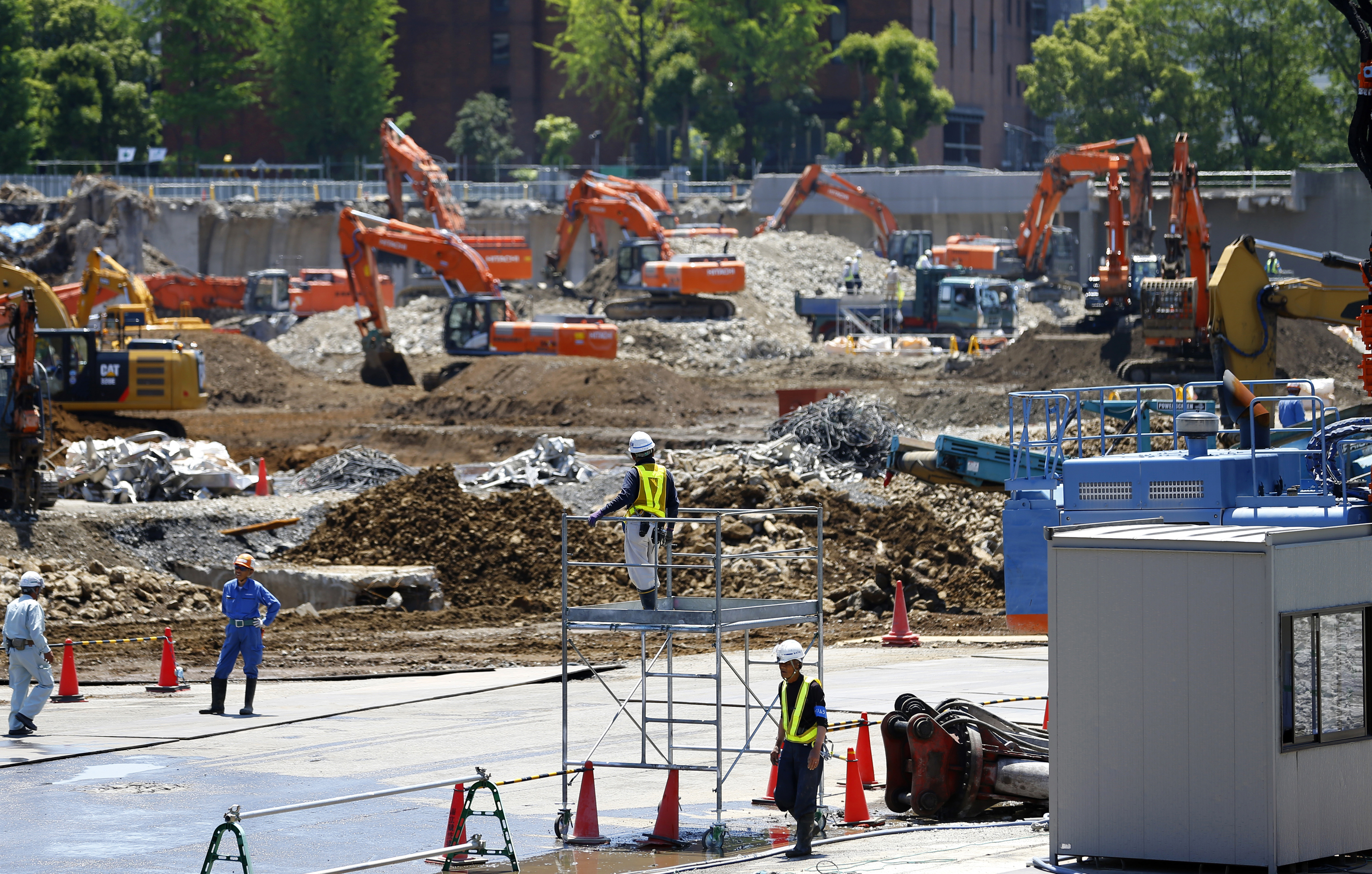 In this photo taken on May 13, 2015, Japan's National Stadium is dismantled for the renovation for the 2020 Tokyo Olympics, in Tokyo. Japan's government is on the defensive as criticism mounts over the spiraling cost to build the main stadium for the 2020