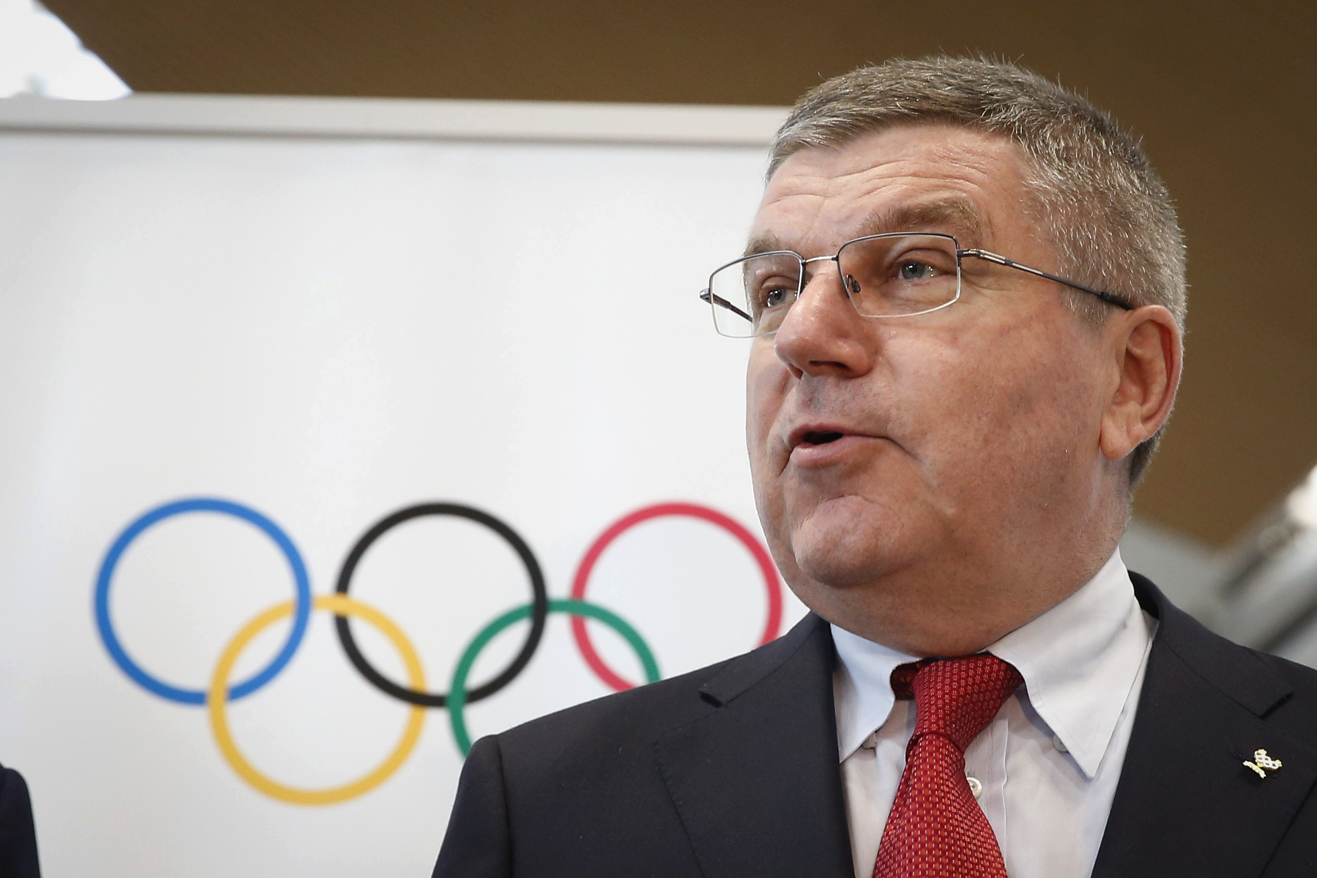 Thomas Bach, president of the International Olympic Committee (IOC) speaks to the media during a photo call at Kuala Lumpur International Airport in Sepang, Malaysia, on Friday, July 24, 2015. (AP Photo/Vincent Thian)