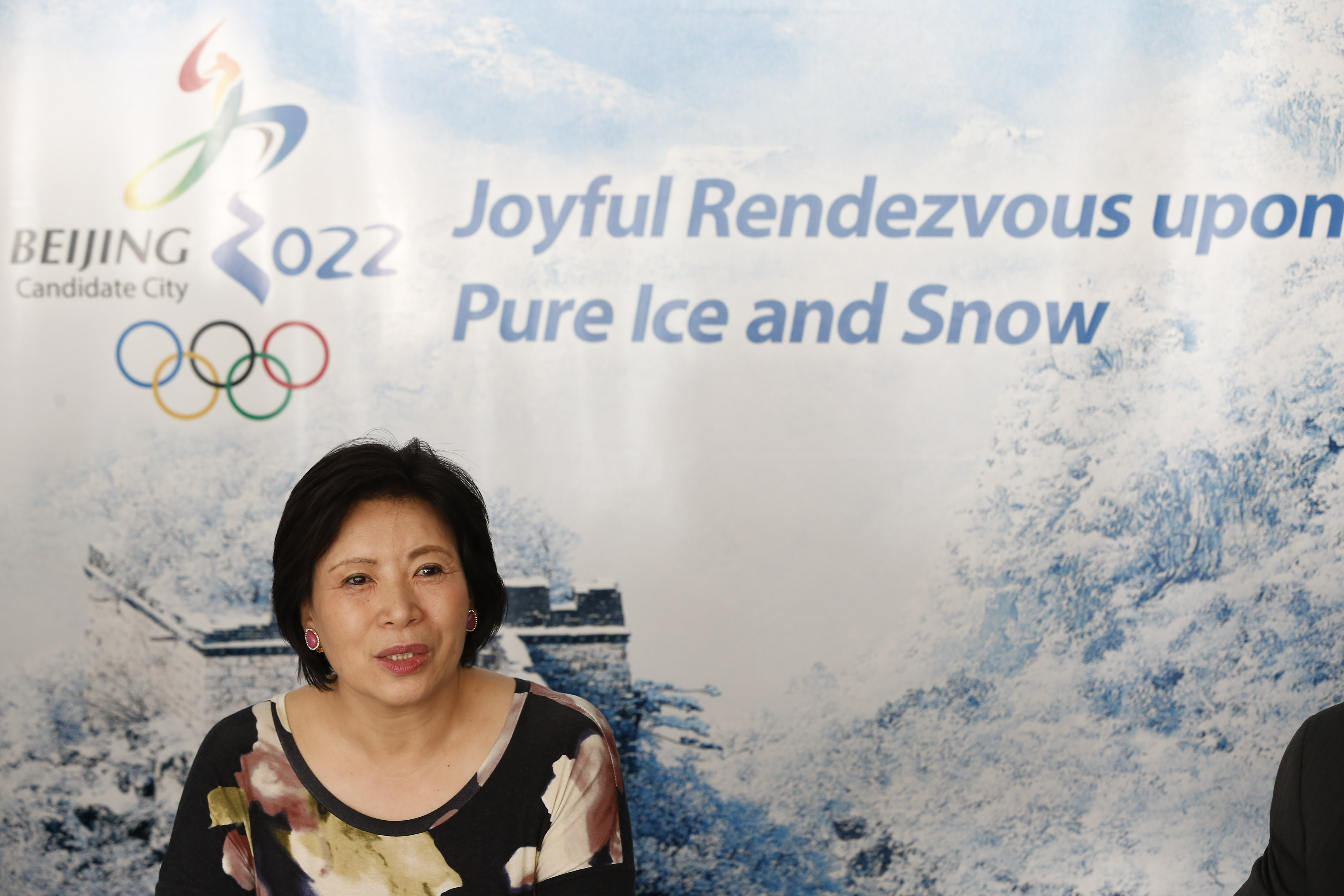 Wang Hui, Spokeswomen of Beijing bid committee, answers a question during a press conference at a hotel in Kuala Lumpur, Malaysia, Monday, July, 27, 2015. Malaysia is hosting the 128th International Olympic Committee executive board meeting where the vote