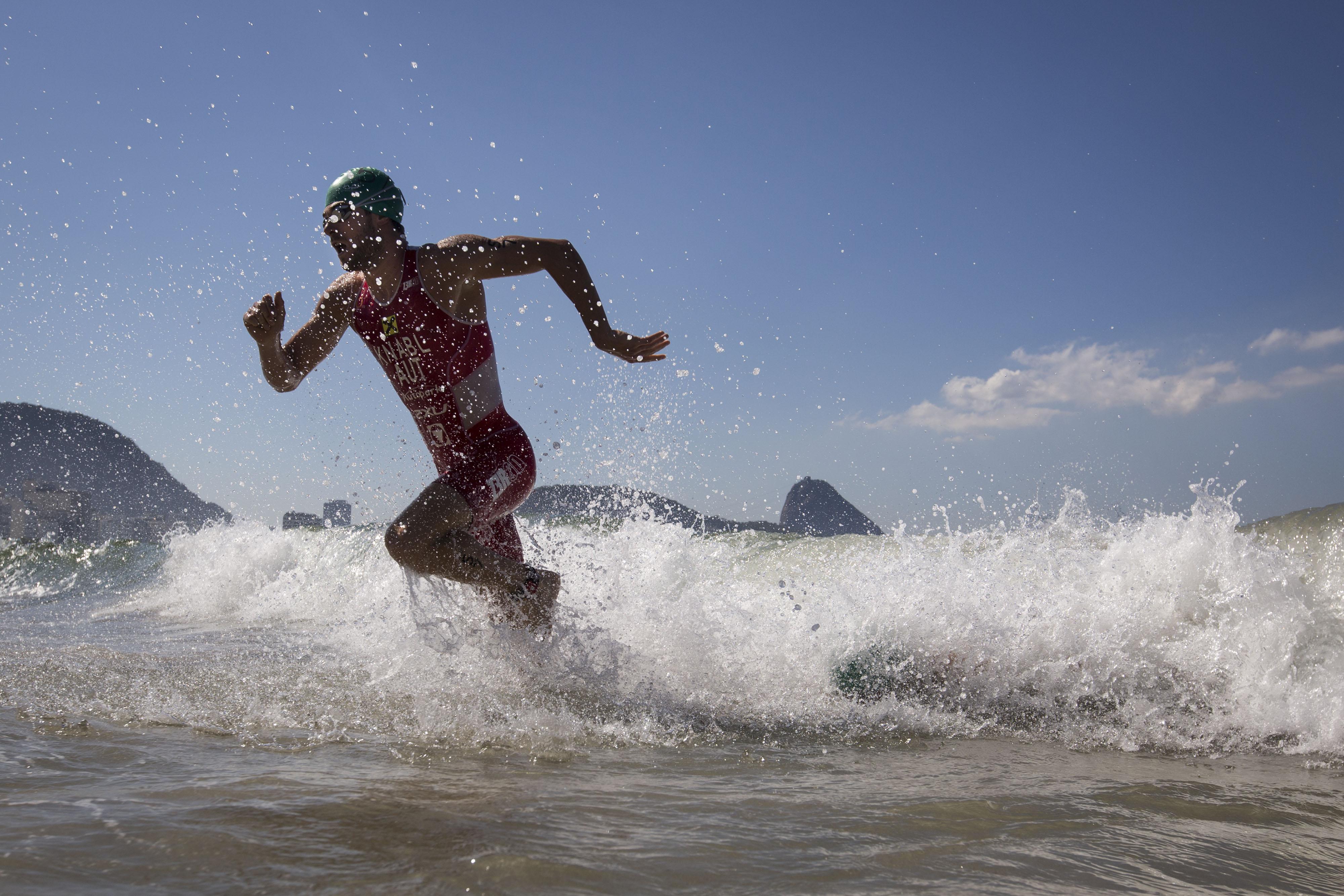 Alois Jnabl of Austria exits the water during the men's triathlon ITU World Olympic Qualification Event in Rio de Janeiro, Brazil, Sunday, Aug. 2, 2015. The World Olympic Qualification is a test event for the Rio 2016 Olympics. (AP Photo/Felipe Dana)