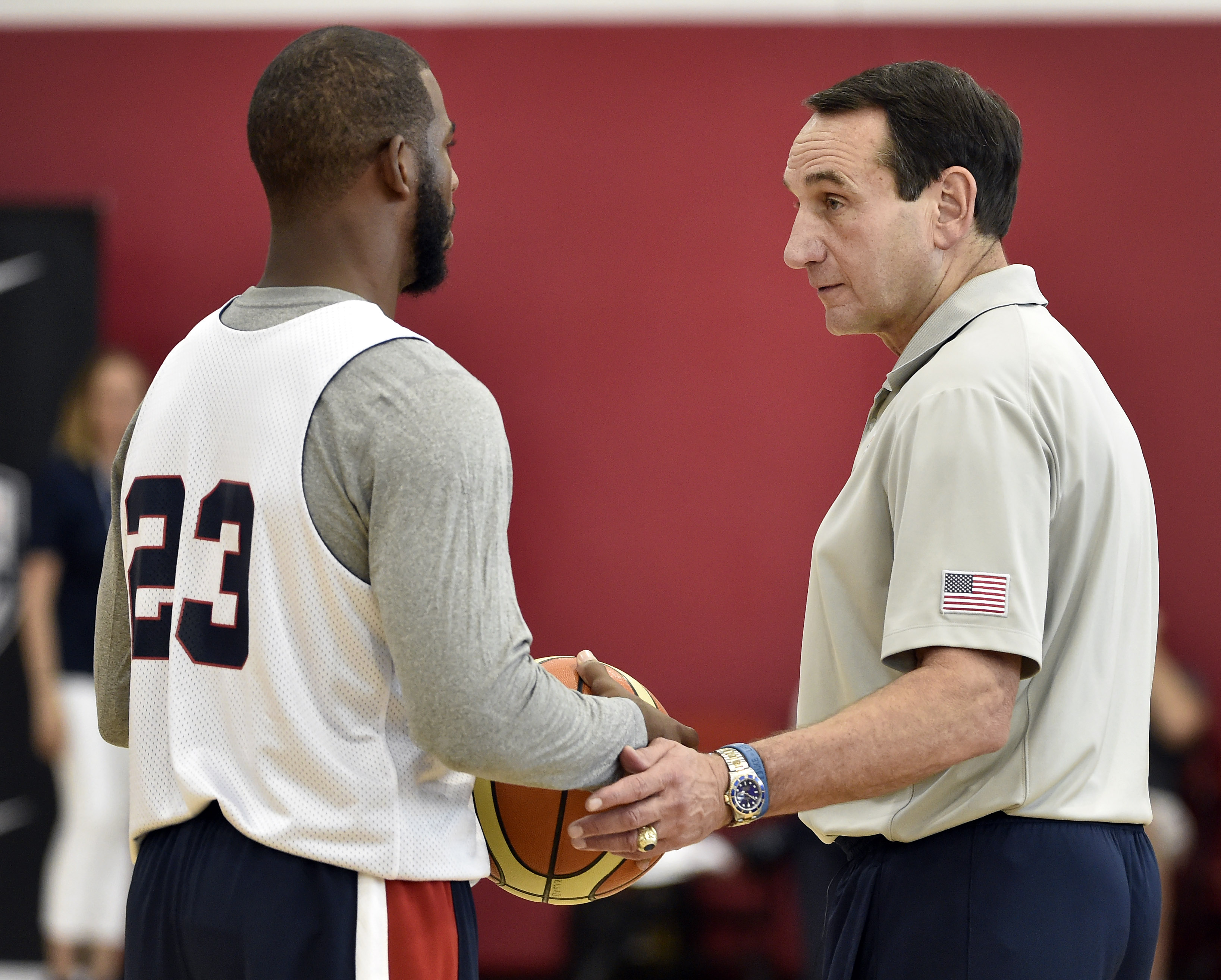 U.S men's basketball coach Mike Krzyzewski, right, speaks with Chris Paul during the team's minicamp Tuesday, Aug. 11, 2015, in Las Vegas. (AP Photo/David Becker)
