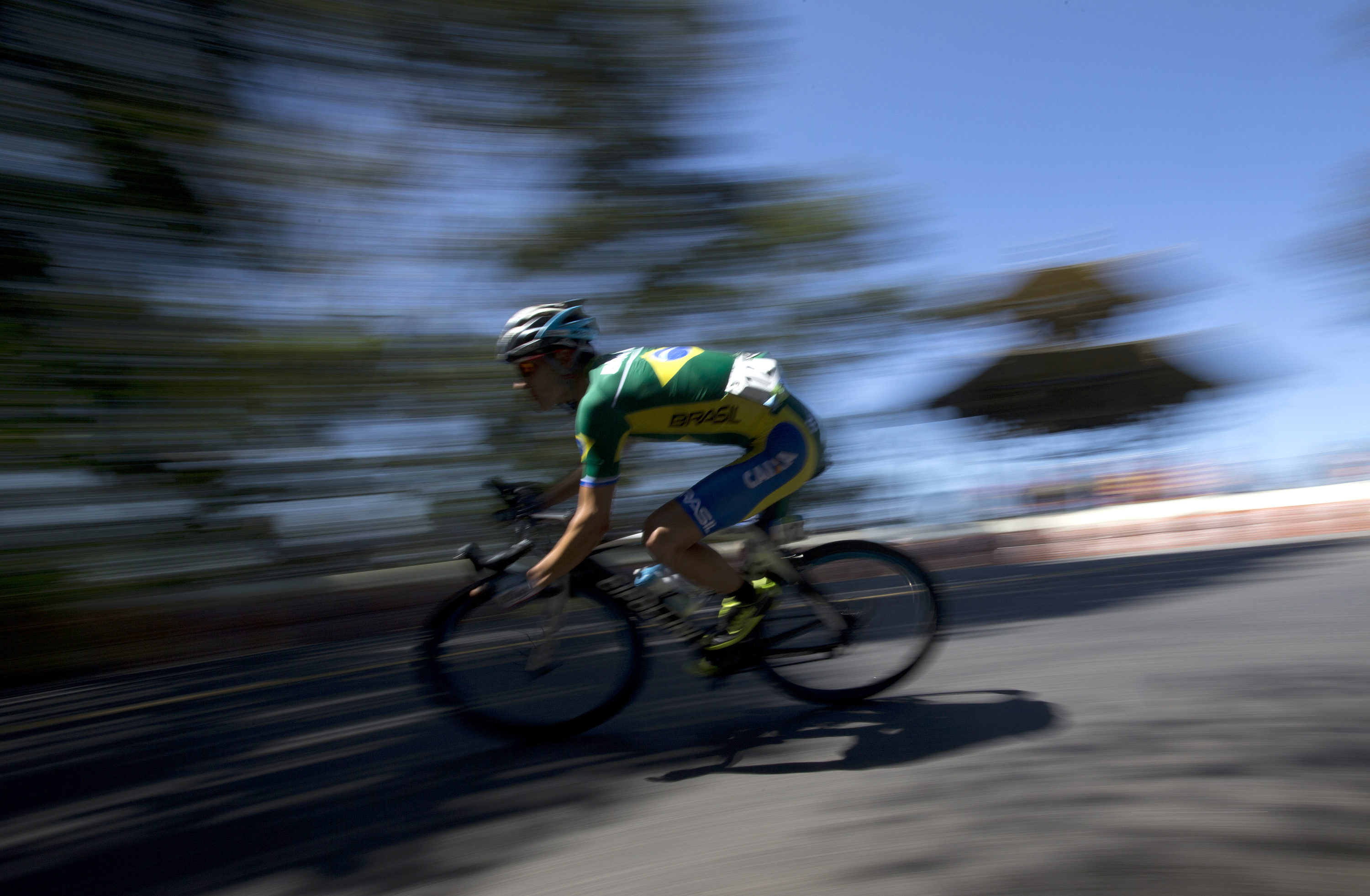 A Brazilian athlete competes during the International Road Cycling Challenge test event ahead the Rio 2016 Olympic Games in Rio de Janeiro, Brazil, Sunday, Aug. 16, 2015. (AP Photo/Silvia Izquierdo)