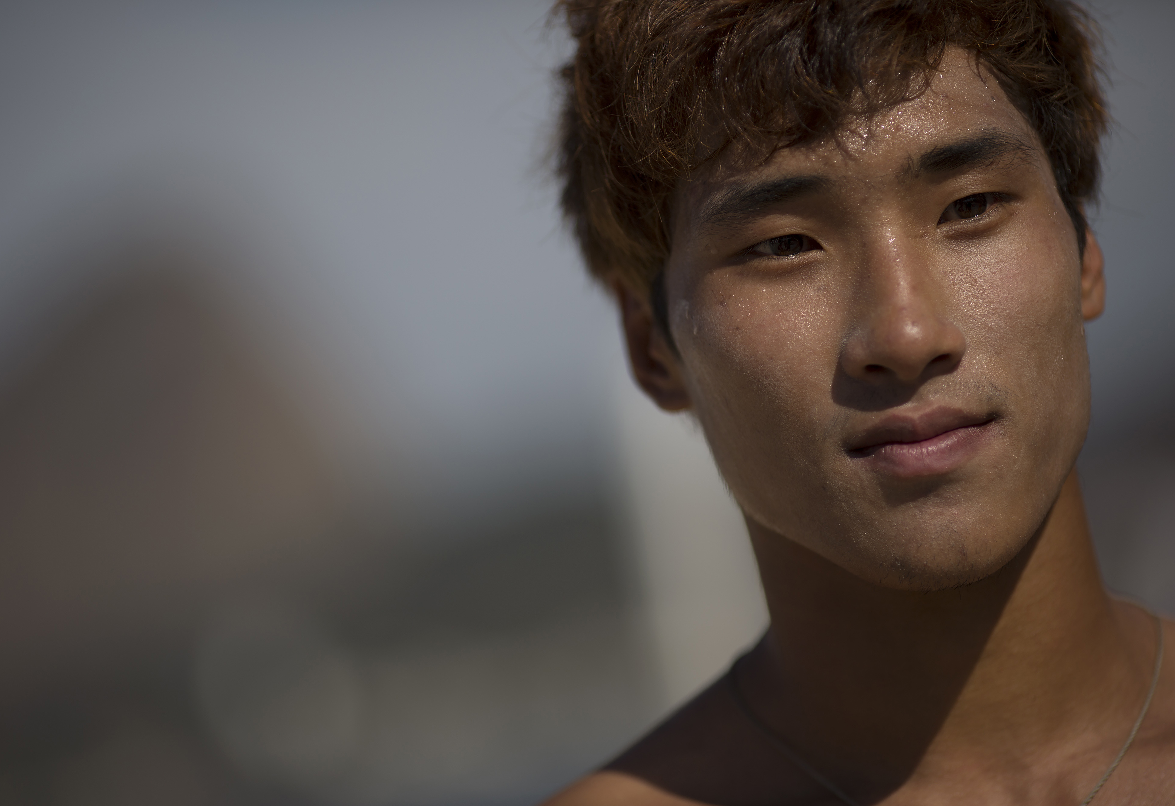 South Korean Wonwoo Cho pauses during an interview after competing during the men's RS:X Windsurfer test event, ahead of the Rio 2016 Olympic Games, in Guanabara Bay, Rio de Janeiro, Brazil, Wednesday, Aug. 19, 2015. Wonwoo Cho is one of four athletes to