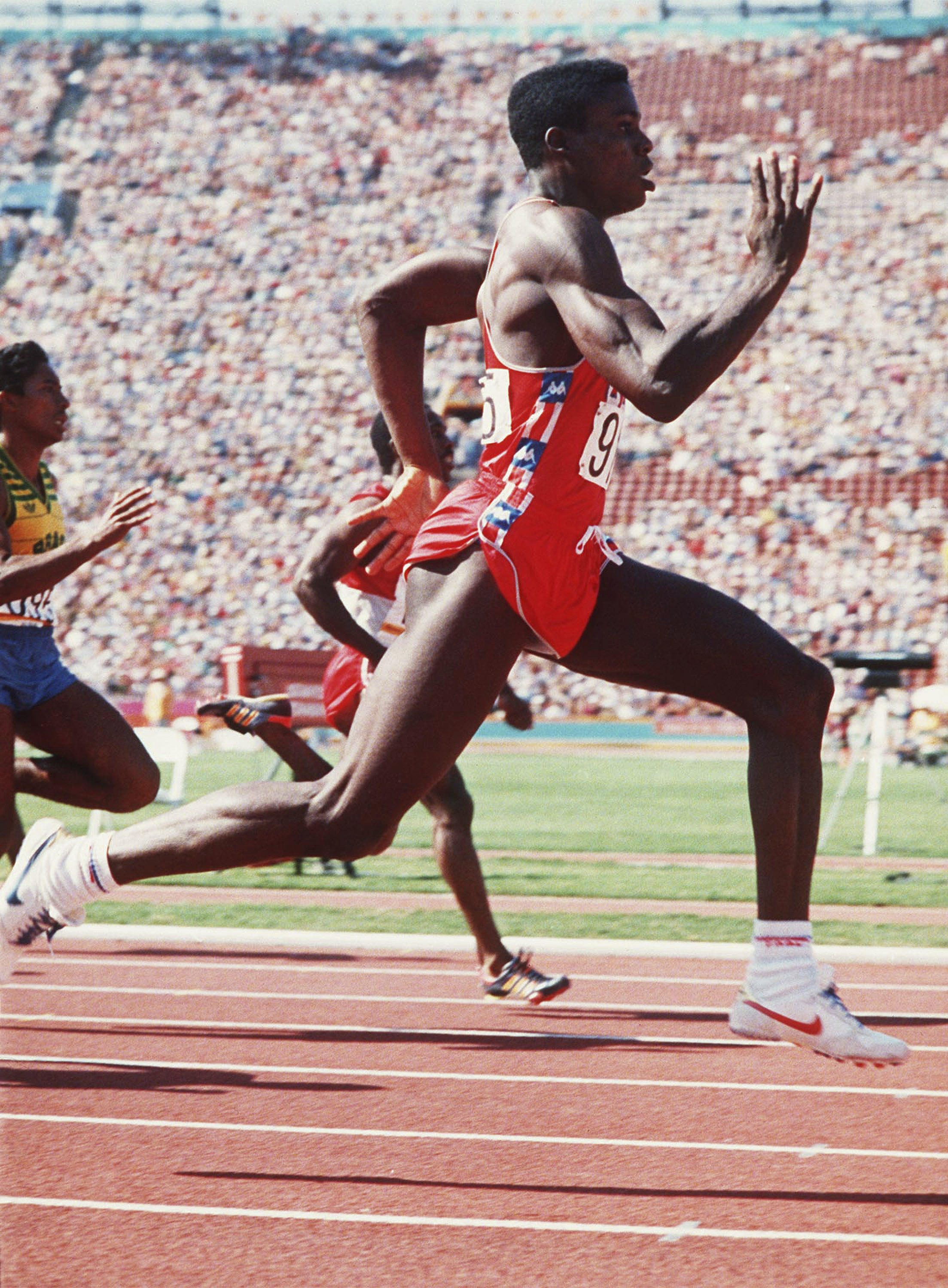FILE - In this Aug. 8, 1984, file photo, U.S. athlete Carl Lewis runs the men's 200 meters race. Lewis won the gold medal. The U.S. Olympic Committee has formally named the city of Los Angeles as the U.S. bid to host the 2024 Olympics Tuesday, Sept. 1, 20