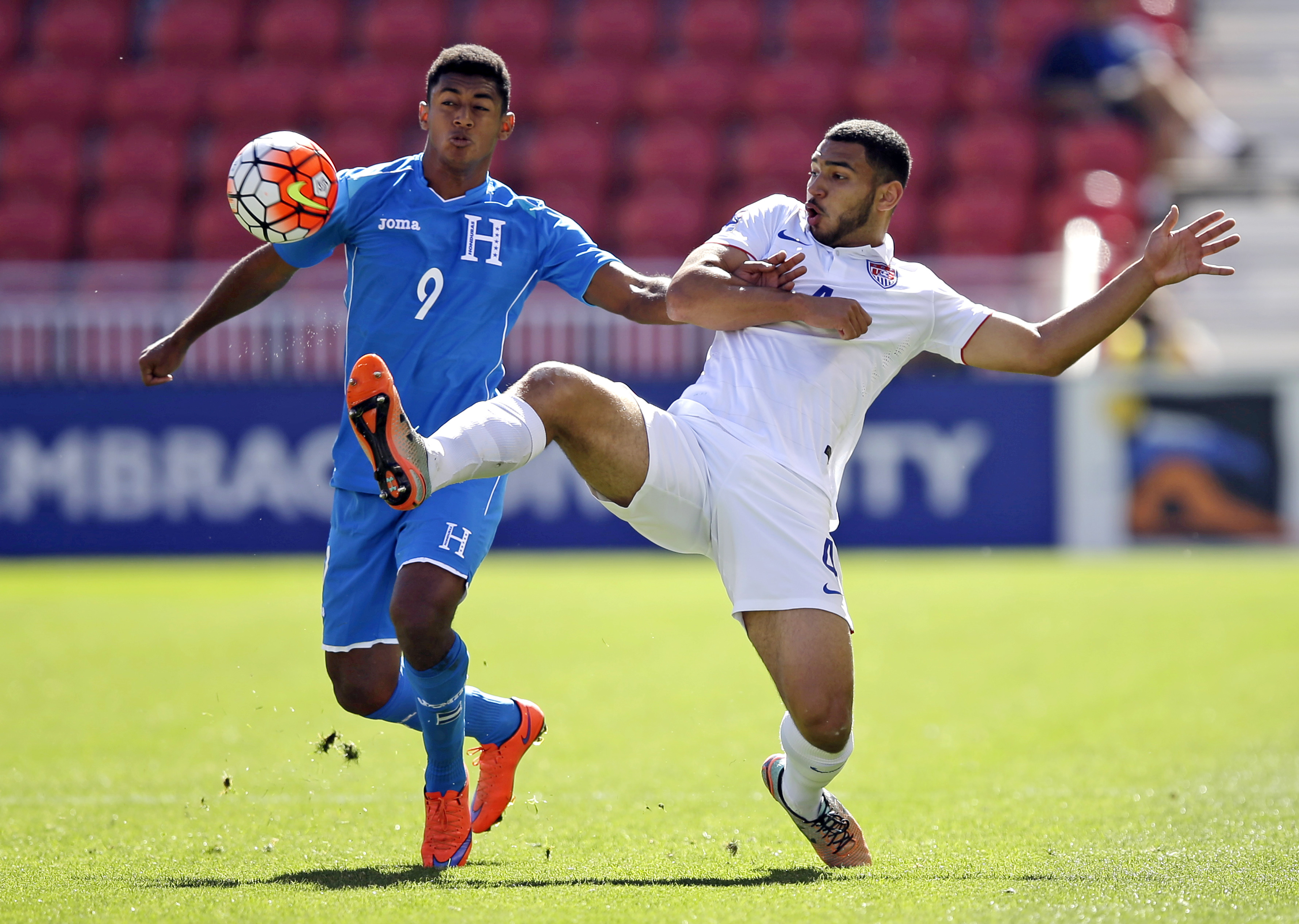 Honduras forward Antony Lozano (9) battles for the ball against United States defender Cameron Carter-Vickers (4) during the first half of a CONCACAF men's Olympics semifinal qualifying soccer match, Saturday, Oct. 10, 2015, in Sandy, Utah. (AP Photo/Rick