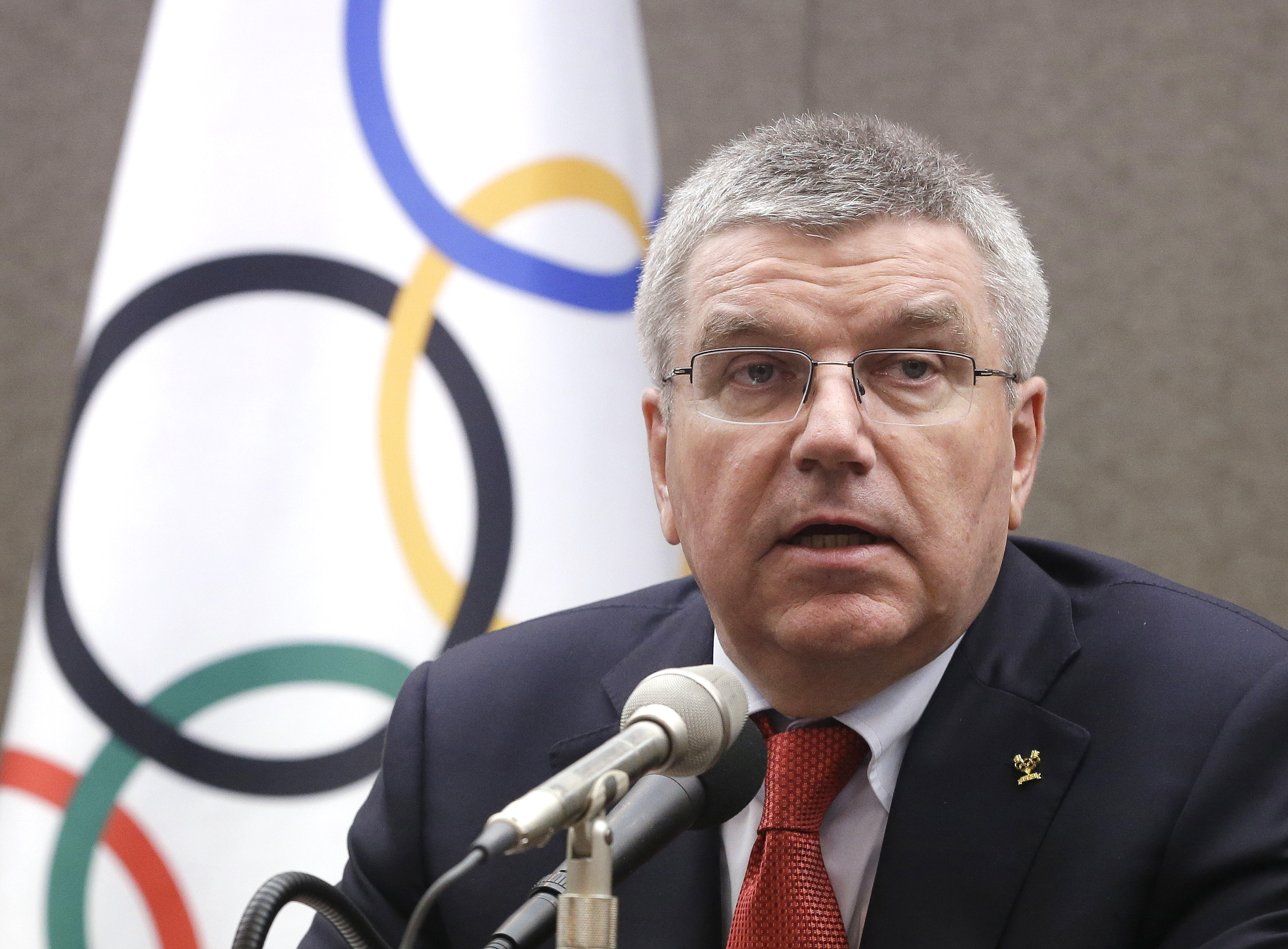 FILE - In this Wednesday, Aug. 19, 2015 file photo, International Olympic Committee (IOC) President Thomas Bach speaks during a press conference in Seoul, South Korea. Russia's track and field athletes will be cleared to compete in the Olympics in Rio de