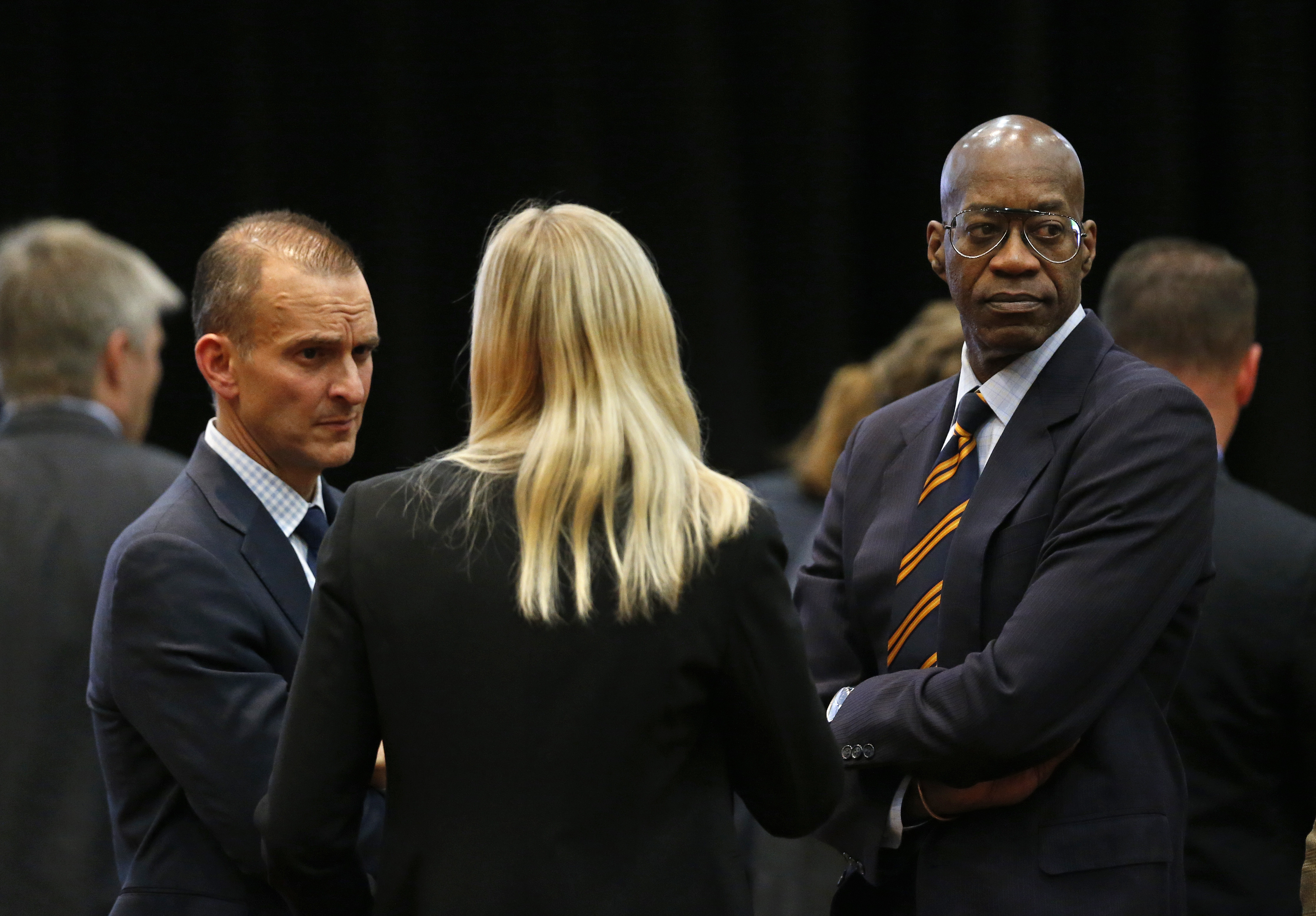U.S. Olympic track champion Edwin Moses, right, talks with Travis Tygart, CEO of the U.S. Anti-Doping Agency, left, and Zimbabwean Olympic swimmer Kirsty Coventry, during a break in a meeting of the World Anti-Doping Agency (WADA), at the Broadmoor Hotel