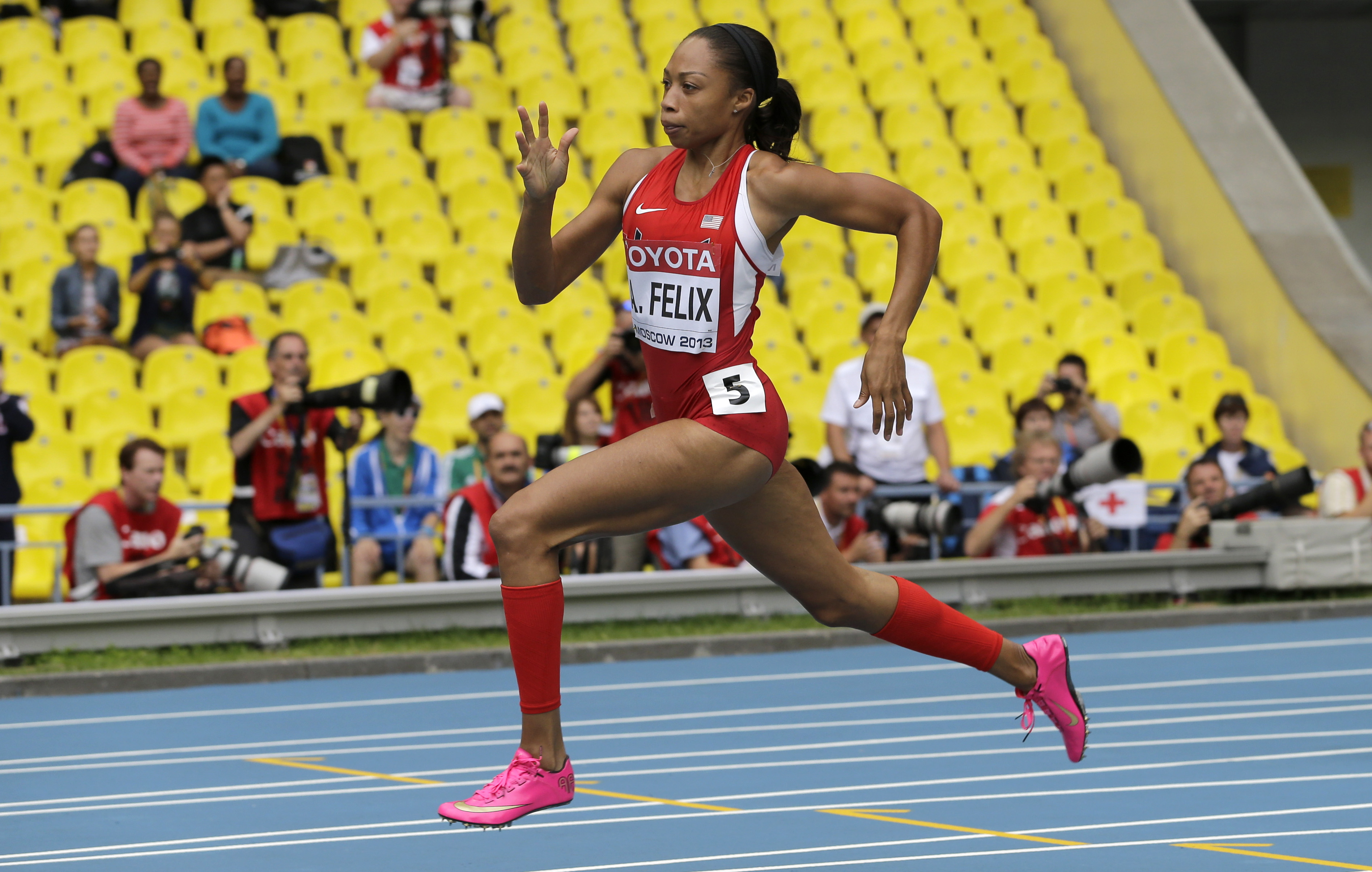 FILE - In this Aug. 15, 2013, file photo, United States' Allyson Felix competes in a women's 200-meter heat at the World Athletics Championships in Moscow. Felix's training is all geared toward the finish line in the 200 and 400 meters at the Rio Olympics