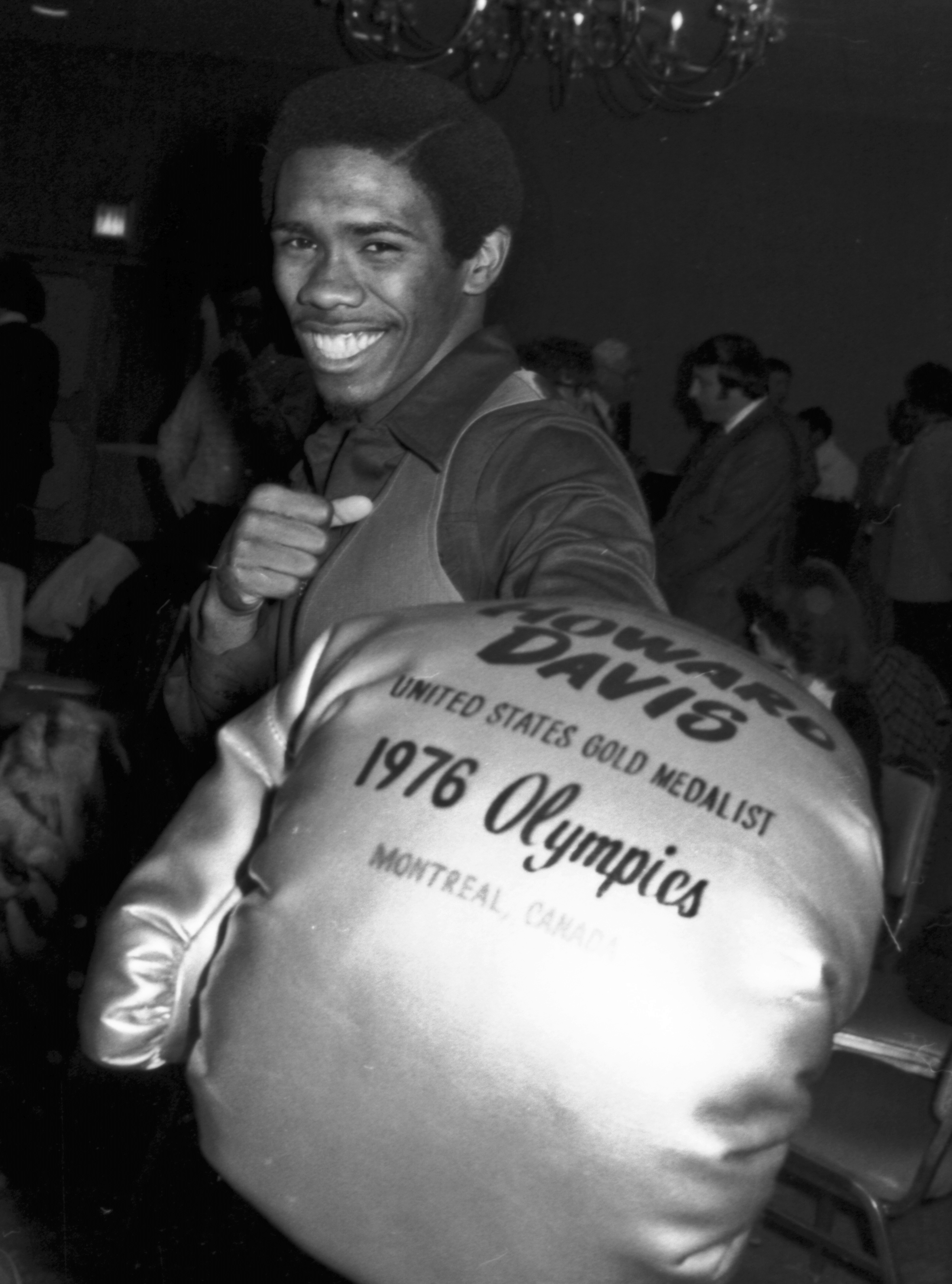 FILE - In this Dec. 17, 1976, file photo, Howard Davis, the Olympic gold medal winner in the lightweight boxing division, poses for photographers at a press conference in New York, where he announced that he was turning professional. The former Olympic ch