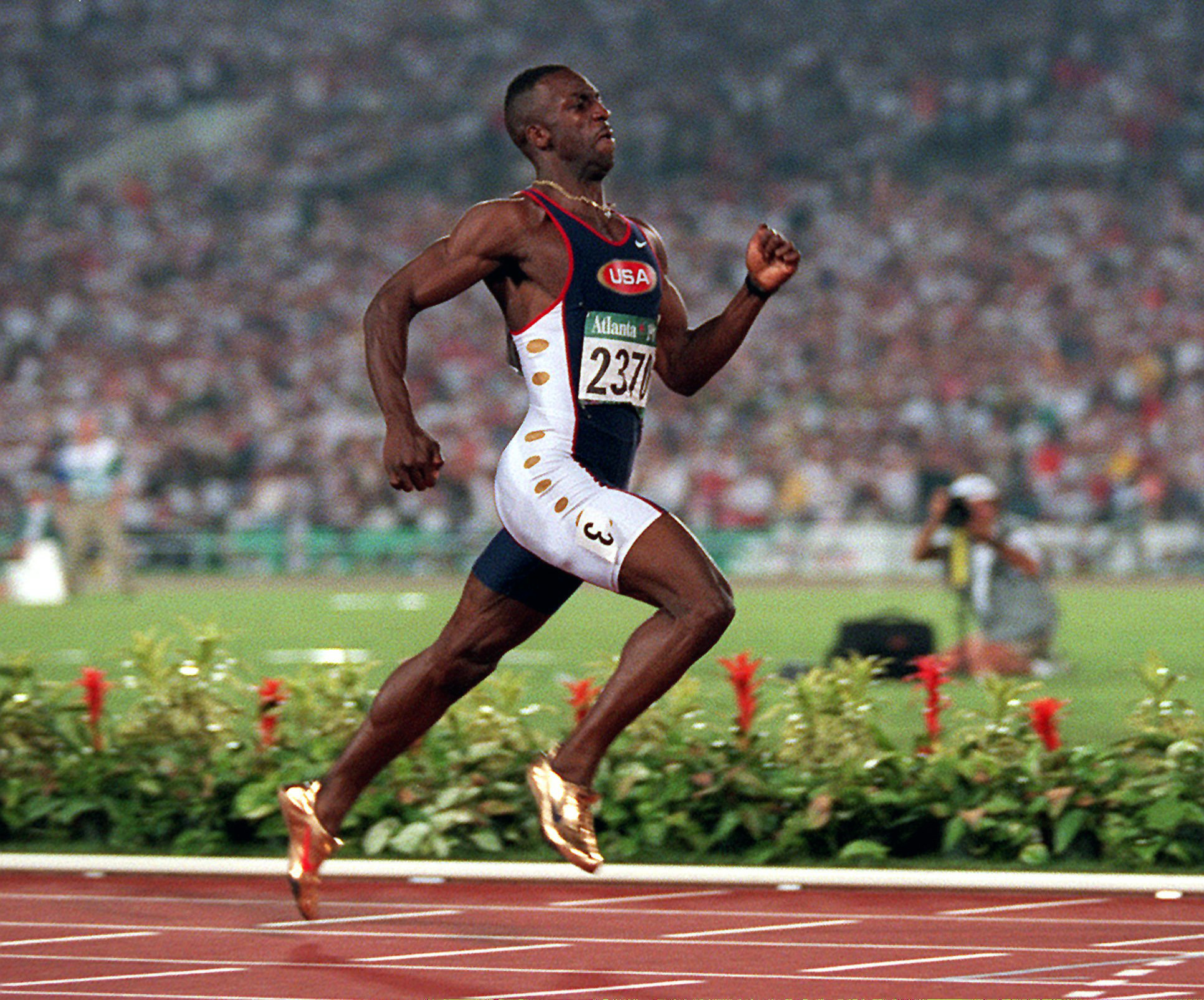 FILE - This Thursday Aug. 1, 1996 file photo shows Michael Johnson of the United States runs to win the men's 200 meters in a new world record time of 19.32 at the 1996 Summer Olympic Games in Atlanta.  Track's governing body made a scheduling change for