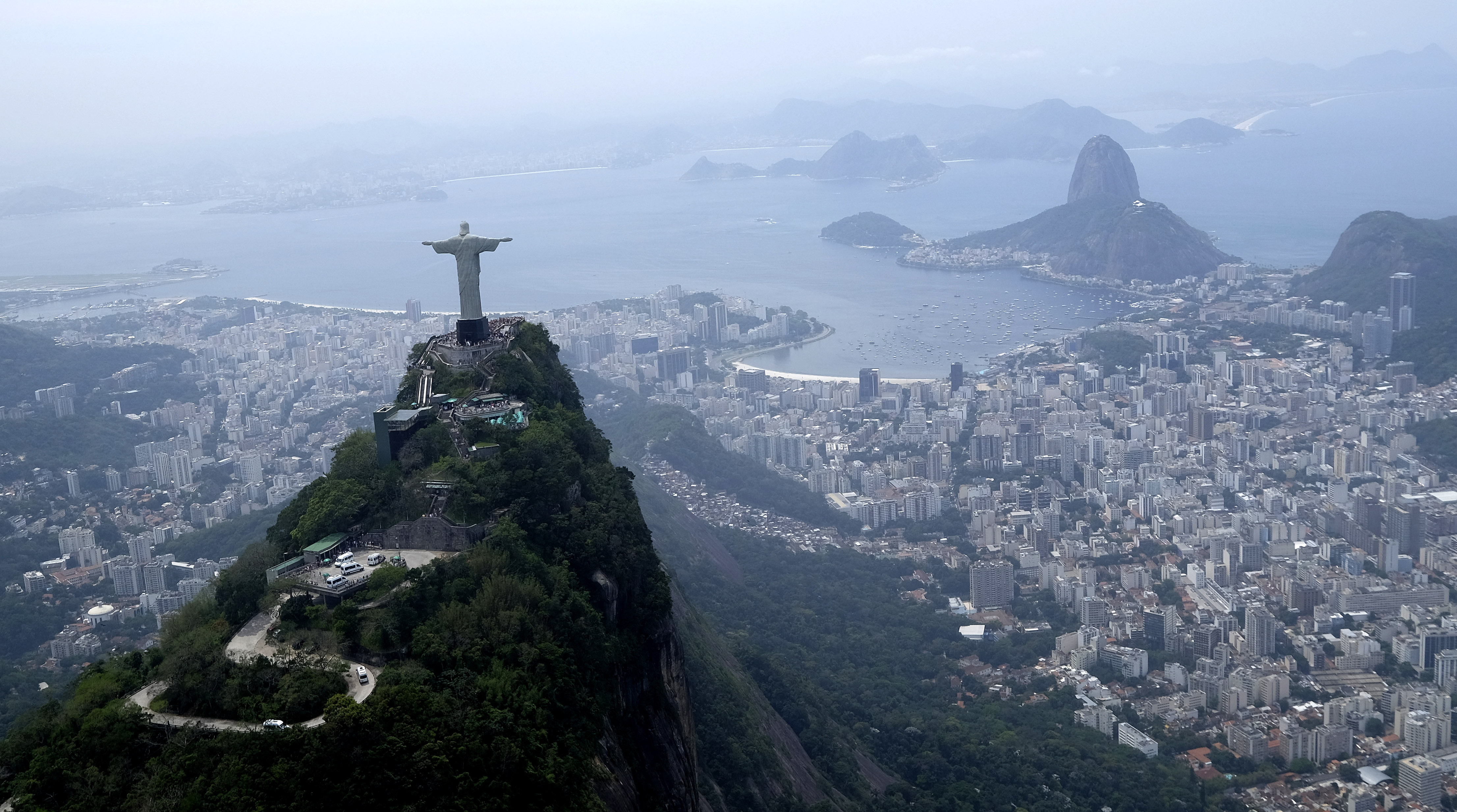 FILE - In this Oct. 9, 2015, file photo, the Christ the Redeemer statue is shown in this aerial view of Rio de Janeiro,Braizl. Organizing committee spokesman Mario Andrada said on Tuesday, Jan, 19, 2016, that they are disappointed with ticket sales with O