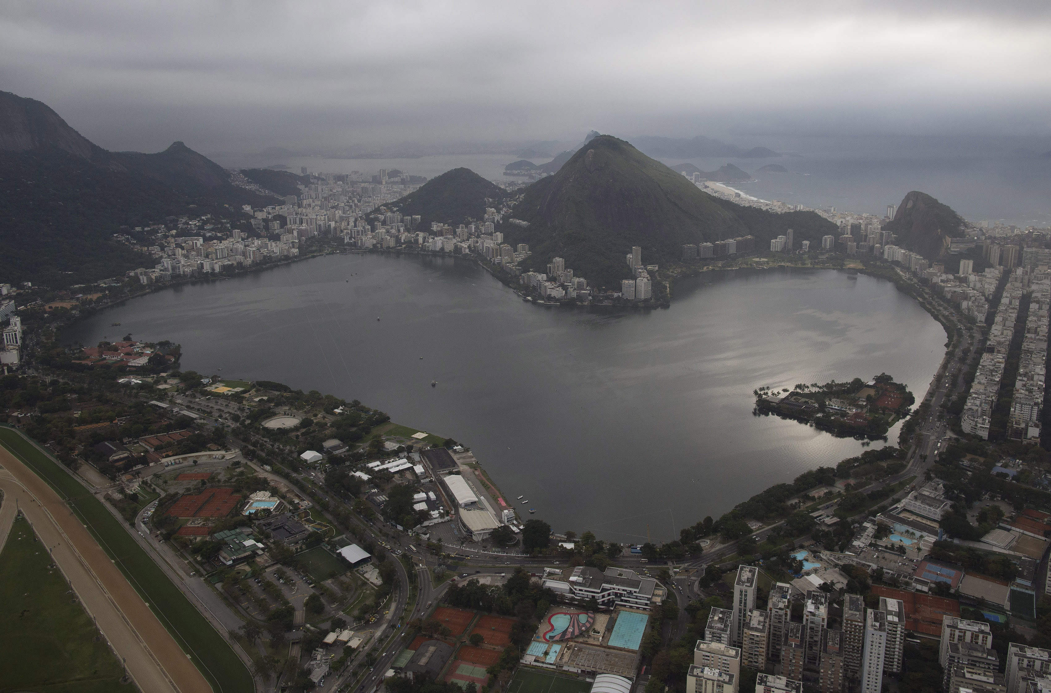 FILE - This July 27, 2015, file photo shows the Rodrigo de Freitas Lake in Rio de Janeiro, Brazil. An Associated Press analysis of water quality found dangerously high levels of viruses and bacteria from human sewage in Olympic and Paralympic venues. The