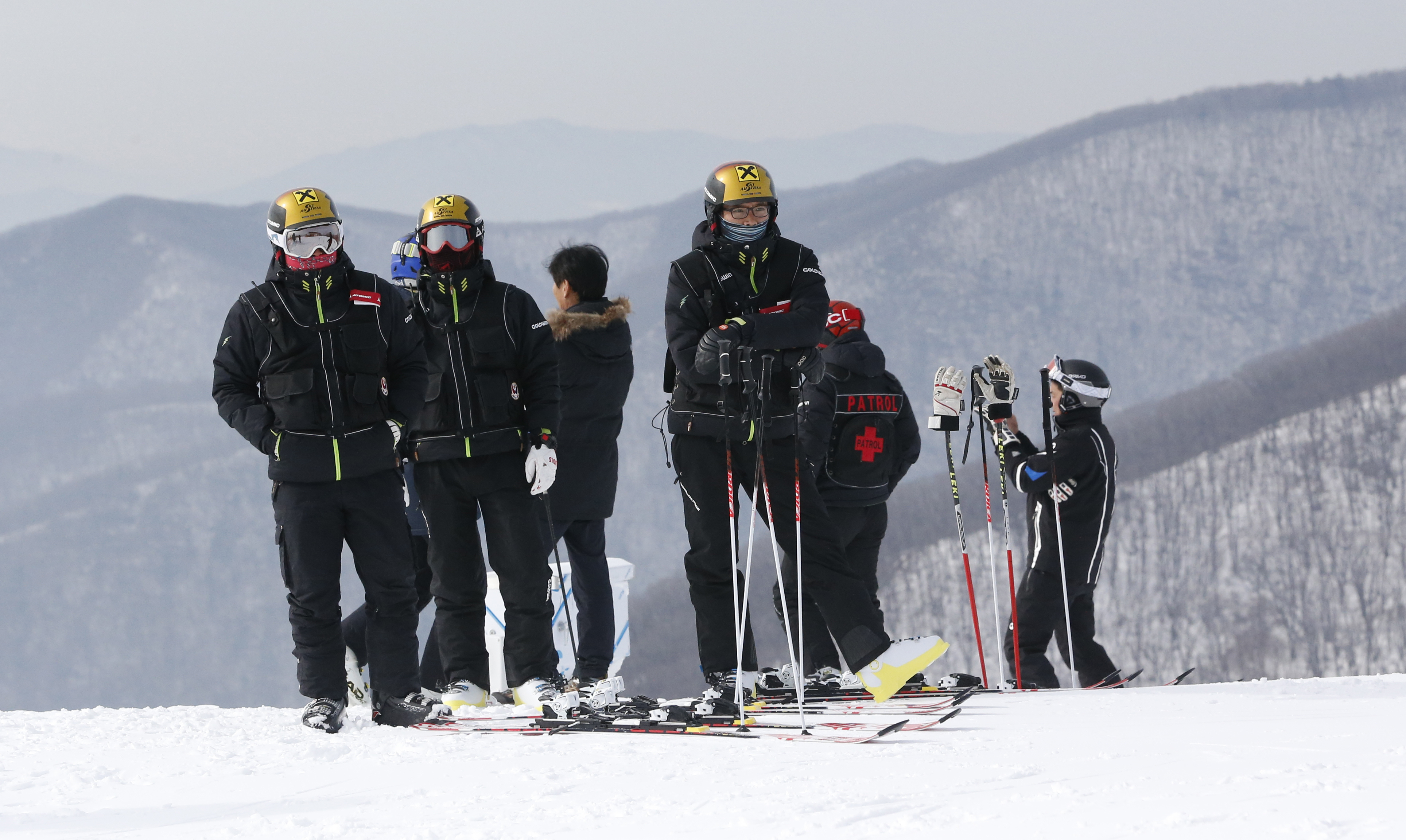 In this Friday, Jan. 22, 2016 photo, Ski course patrols stand at the top of the ski slope which will be the training venue for the upcoming official Test Event of the Pyeongchang 2018 Winter Olympics at the Jeongseon Alpine Centre in Jeongseon, South Kore