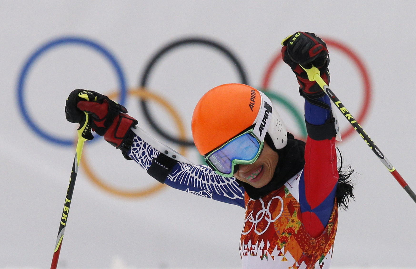 FILE - In this Tuesday, Feb. 18, 2014 file photo, violinist Vanessa Mae competing under her father's surname as Vanessa Vanakorn for Thailand, celebrates after completing the first run of the women's giant slalom at the Sochi 2014 Winter Olympics in Krasn