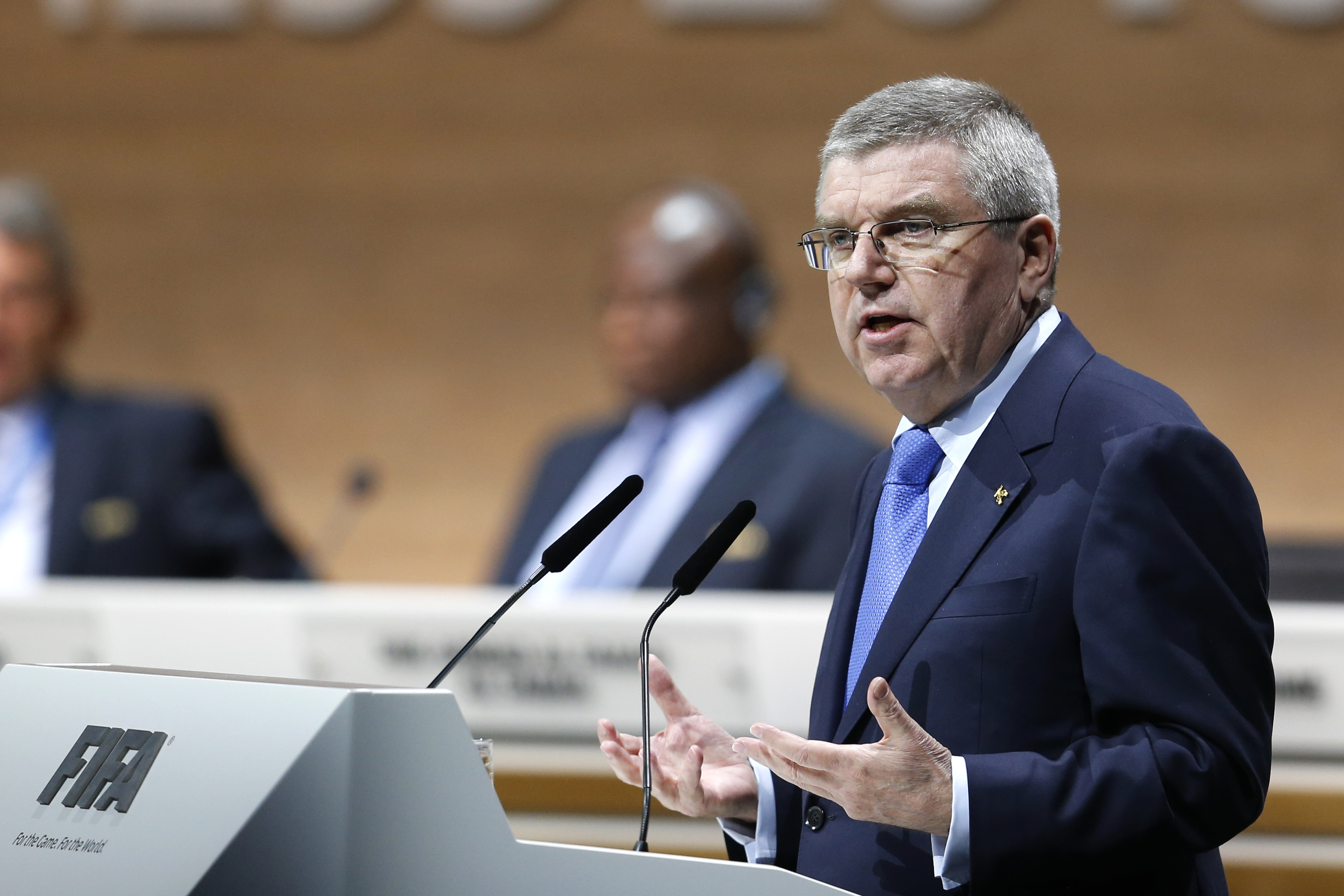 IOC President Thomas Bach speaks during the extraordinary FIFA congress in Zurich, Switzerland, Friday, Feb. 26, 2016. Delegates of the soccer  body FIFA meet to elect a new president. (AP Photo/Michael Probst)