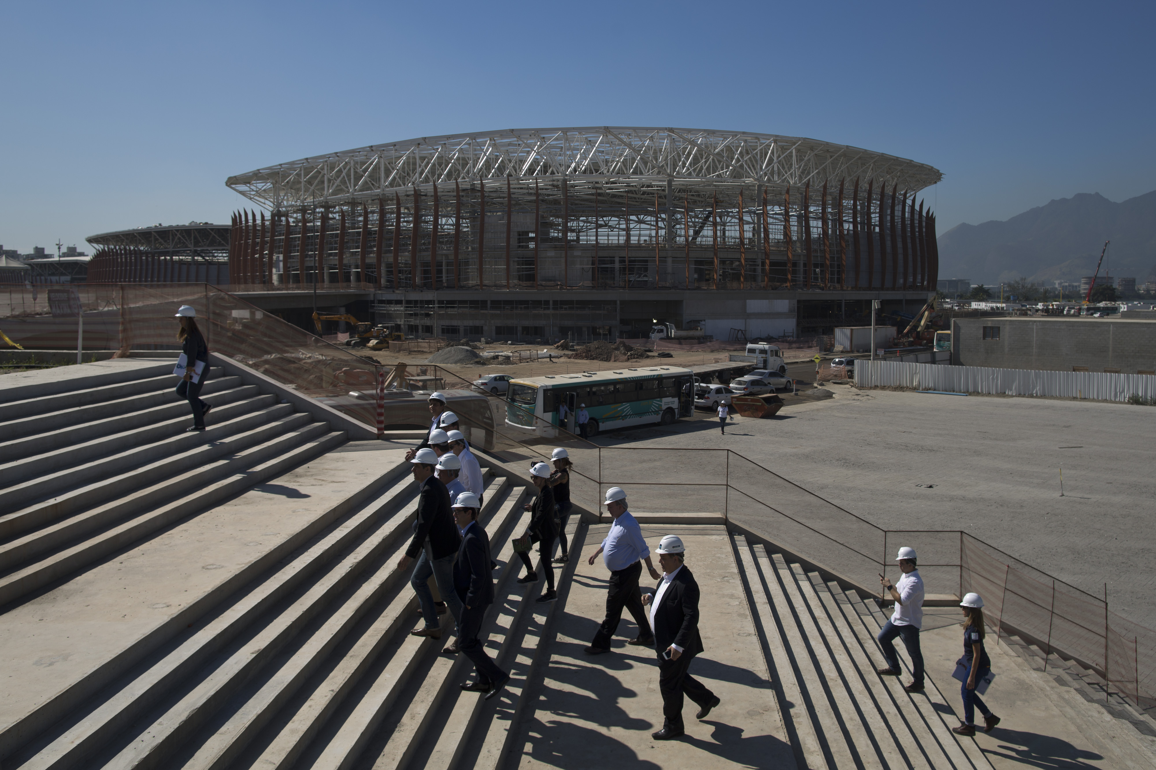 FILE - In this June 11, 2015, file photo, the Arena Carioca 1 is seen in the background as officials visit the Olympic Park of the 2016 Olympics in Rio de Janeiro, Brazil. Hundreds of thousands of foreign visitors are expected for the Olympics, which open