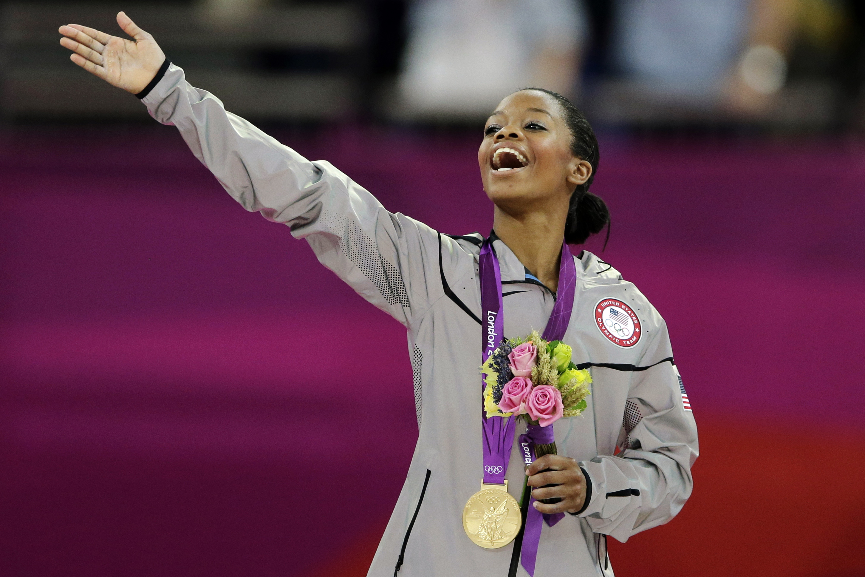 FILE - In this Aug. 2, 2012, file photo, Gabrielle Douglas, of the United States, acknowledges the crowd after receiving her gold medal in the artistic gymnastics women's individual all-around competition at the 2012 Summer Olympics in London. The 2012 Ol