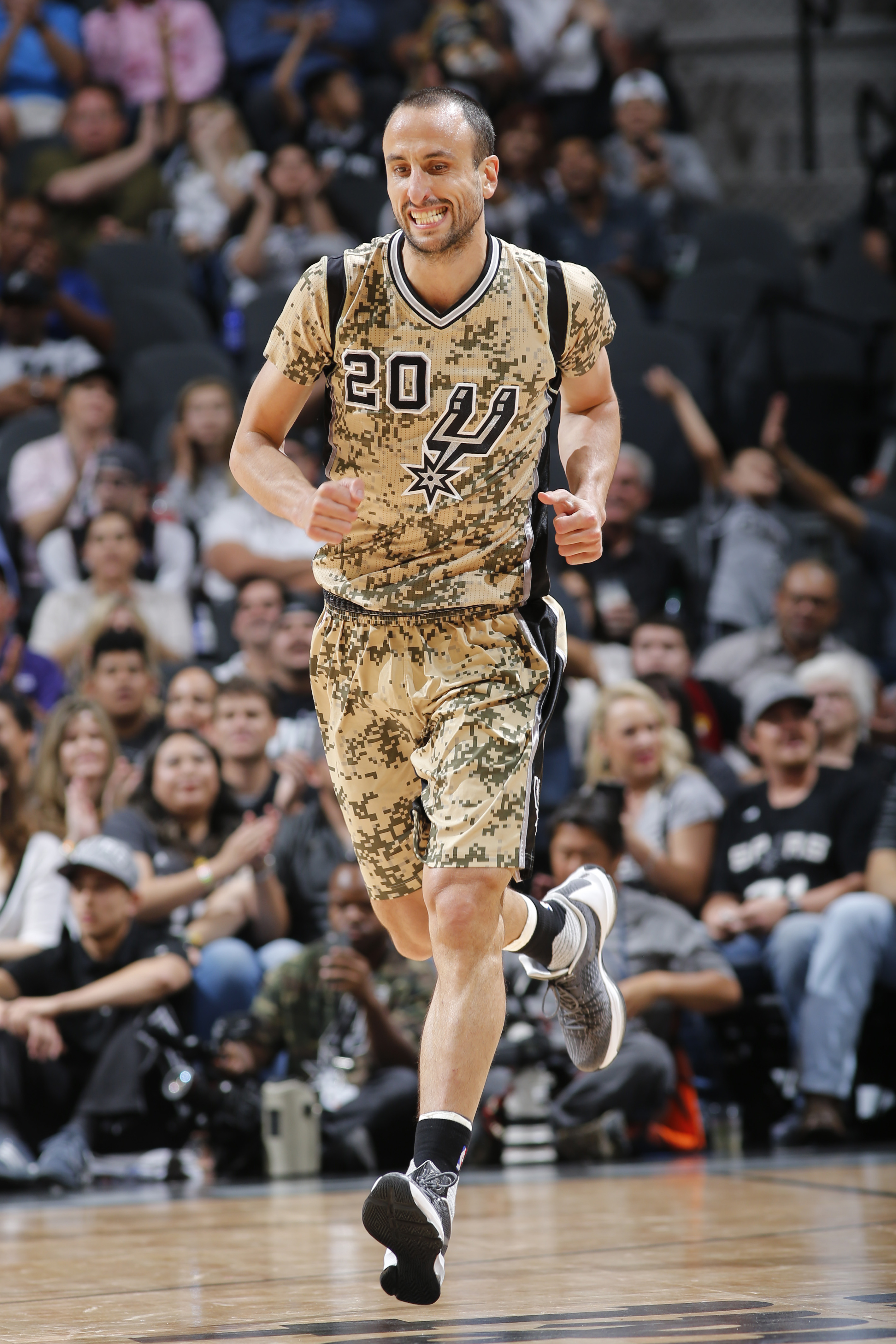 SAN ANTONIO, TX  - MARCH 23: Manu Ginobili #20 of the San Antonio Spurs runs up court against the Miami Heat during the game on March 23, 2016 at AT&T Center in San Antonio, Texas. (Photo by Chris Covatta/NBAE via Getty Images)