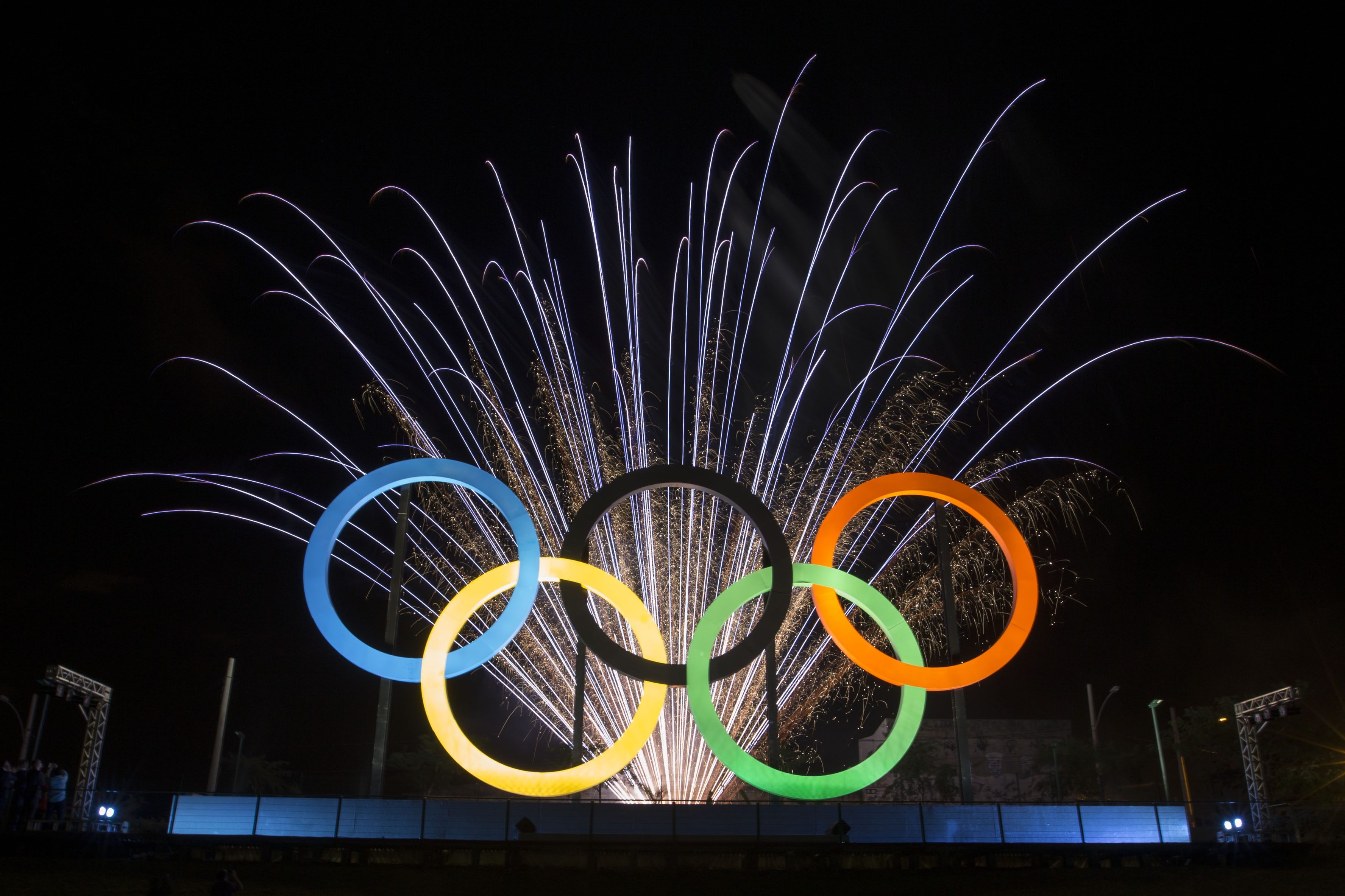 FILE - In this May 20, 2015 file photo, fireworks explode behind the Olympic rings during their inauguration ceremony at Madureira Park in Rio de Janeiro, Brazil. Some people in Brazil are trying to scalp tickets for the Rio de Janeiro Olympics, even befo