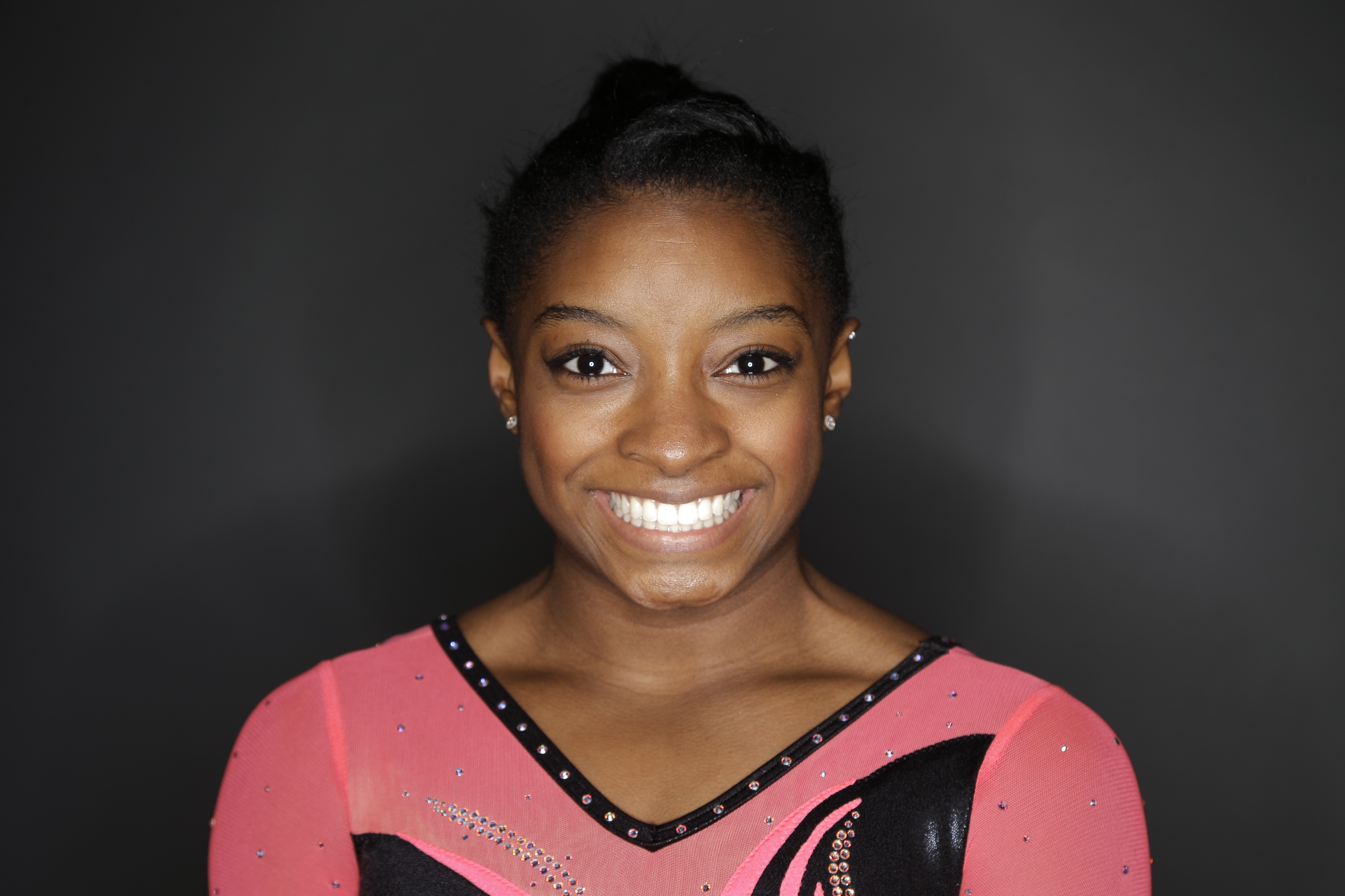 FILE - In this March 7, 2016, file photo, gymnast Simone Biles poses for photos at the 2016 Team USA Media Summit in Beverly Hills, Calif. The three-time defending world gymnastics champion begins her drive to the 2016 Olympics this weekend at the Pacific