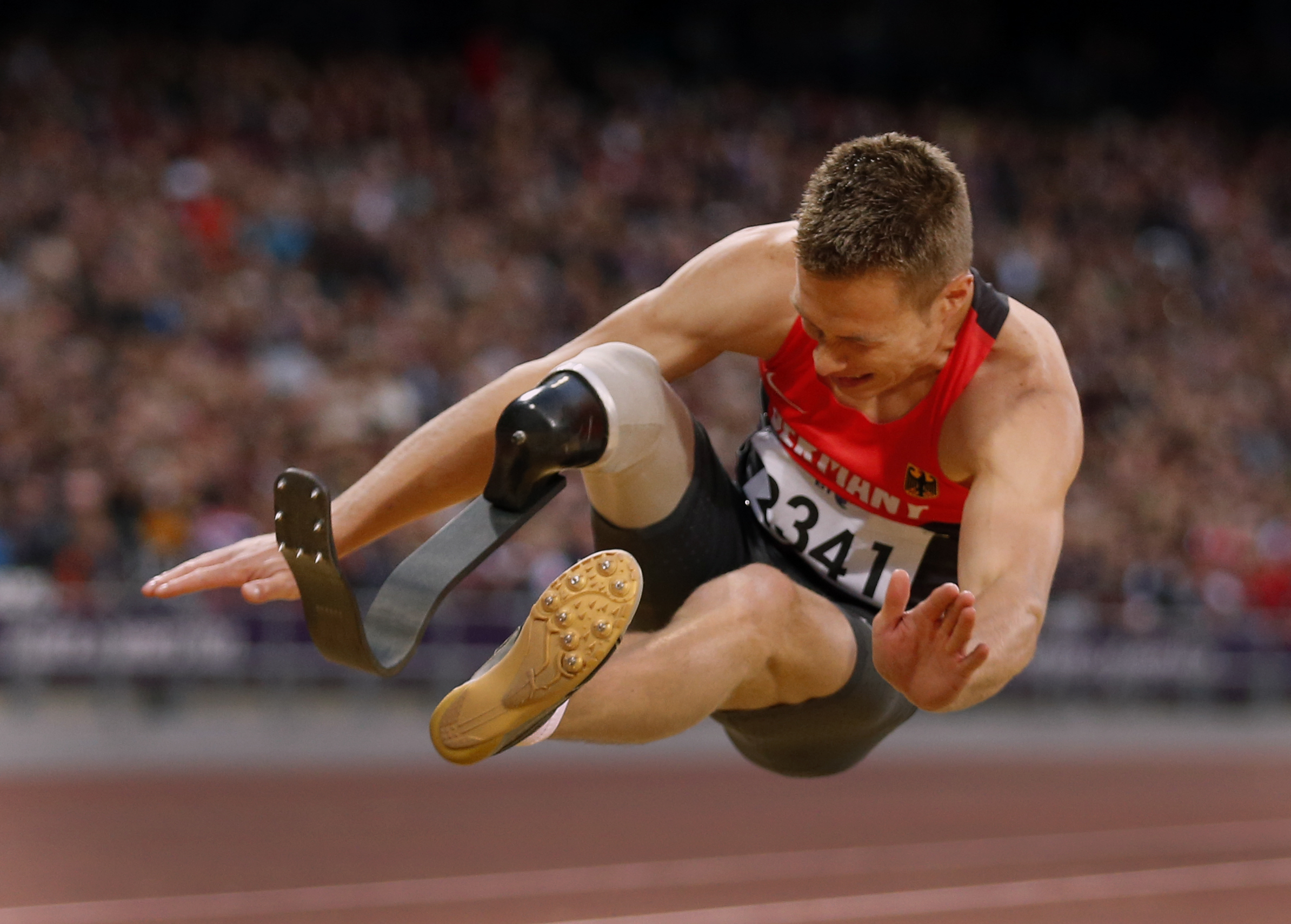 FILE - In this Aug. 31, 2012 file photo Germany's Markus Rehm makes a world record jump of 7.14 meters in the men's long jump F42/44 final during the athletics competition at the 2012 Paralympics in London. Rehm hopes a scientific study will clear him to