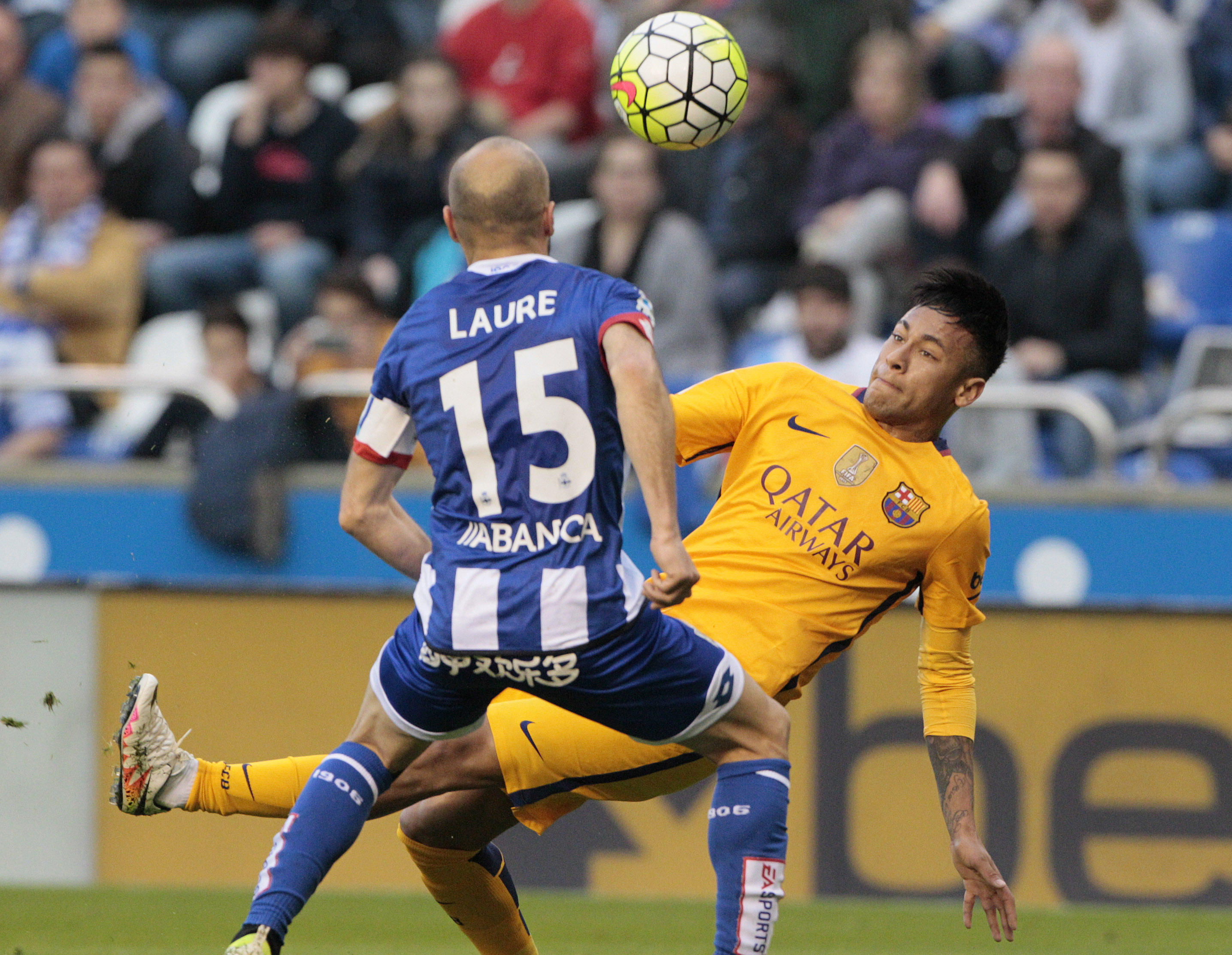 Deportivo's Laure, left, challenges for the ball with Barcelona's Neymar during a Spanish La Liga soccer match between Deportivo Coruna and Barcelona at the Riazor stadium in A Coruna, Spain, Wednesday, April 20, 2016. (AP Photo/Lalo R. Villar)
