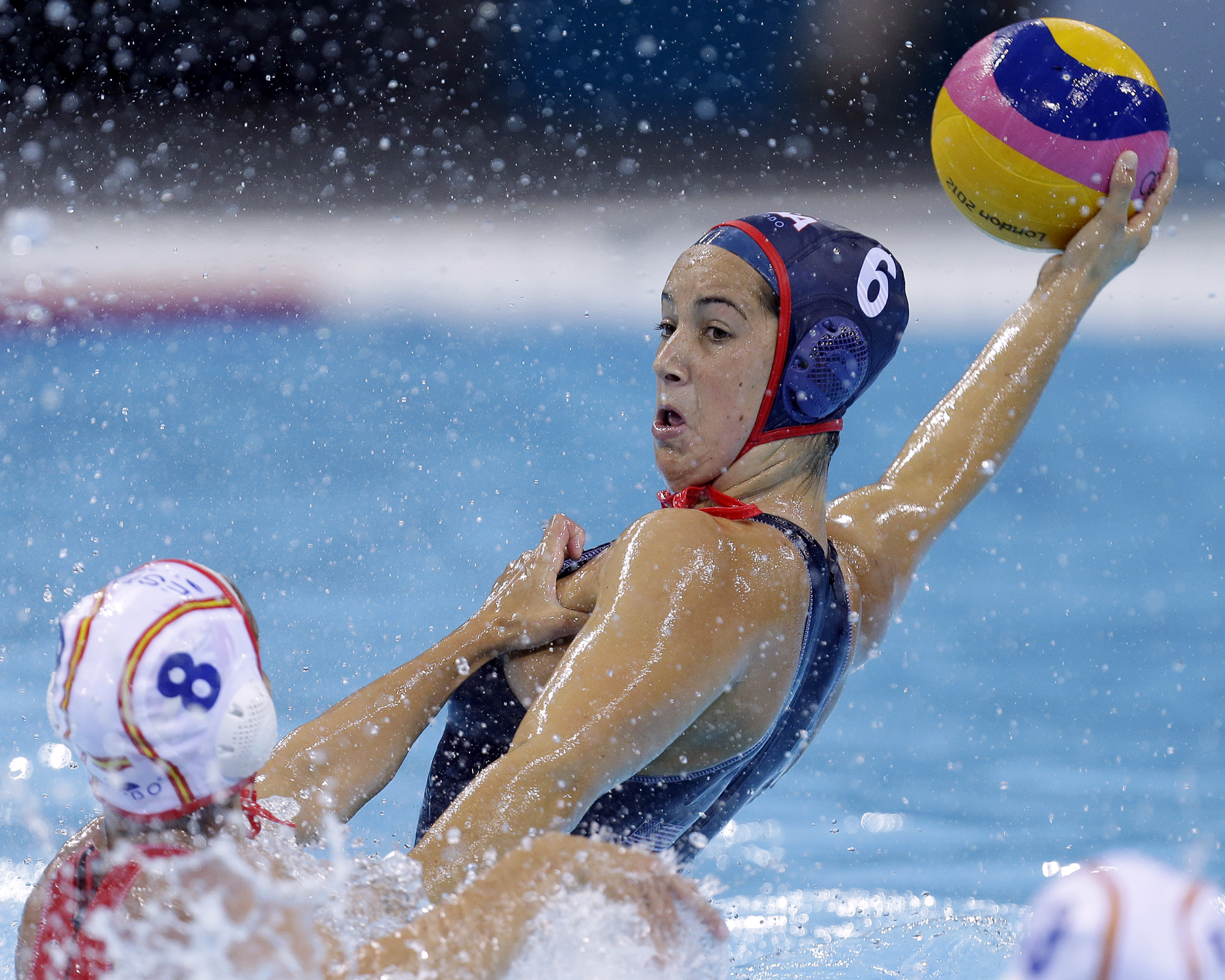 FILE - In this Wednesday, Aug. 1, 2012 file photo, United States' Maggie Steffens, right, is challenged for the ball by Pilar Pena Carrasco of Spain during their women's water polo preliminary round match at the 2012 Summer Olympics in London. Four years