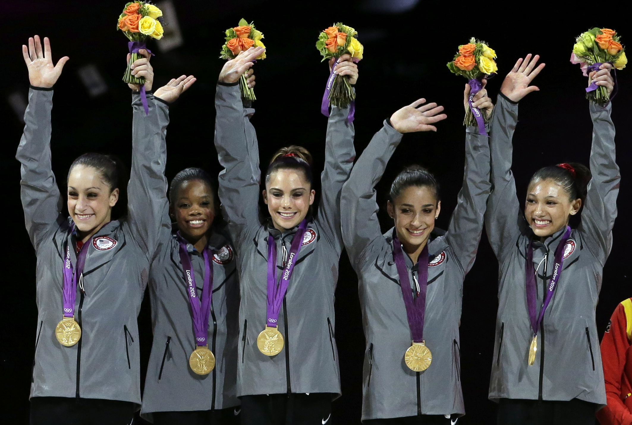 FILE - In this July 31, 2012, file photo, U.S. gymnasts, left to right, Jordyn Wieber, Gabrielle Douglas, McKayla Maroney, Alexandra Raisman and Kyla Ross raise their hands on the podium during the medal ceremony for the Artistic Gymnastic women's team fi