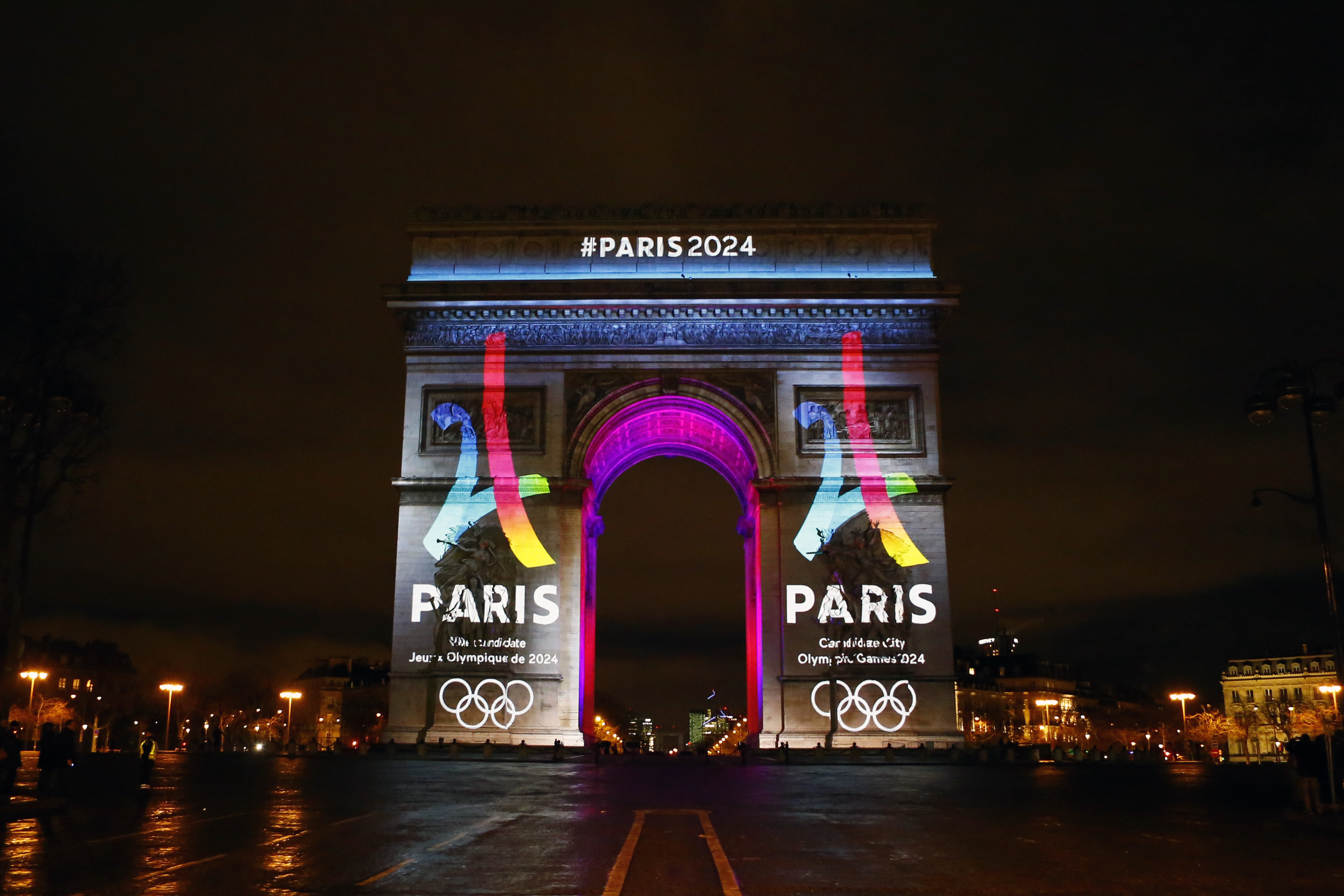 FILE - A Tuesday, Feb. 9, 2016 photo from files showing the Eiffel Tower-shaped logo for the Paris 2024 bid being unveiled on The Arc of Triomphe on the Champs Elysees in Paris. The head of France's Olympic committee said Wednesday, April 27, 2016, that h