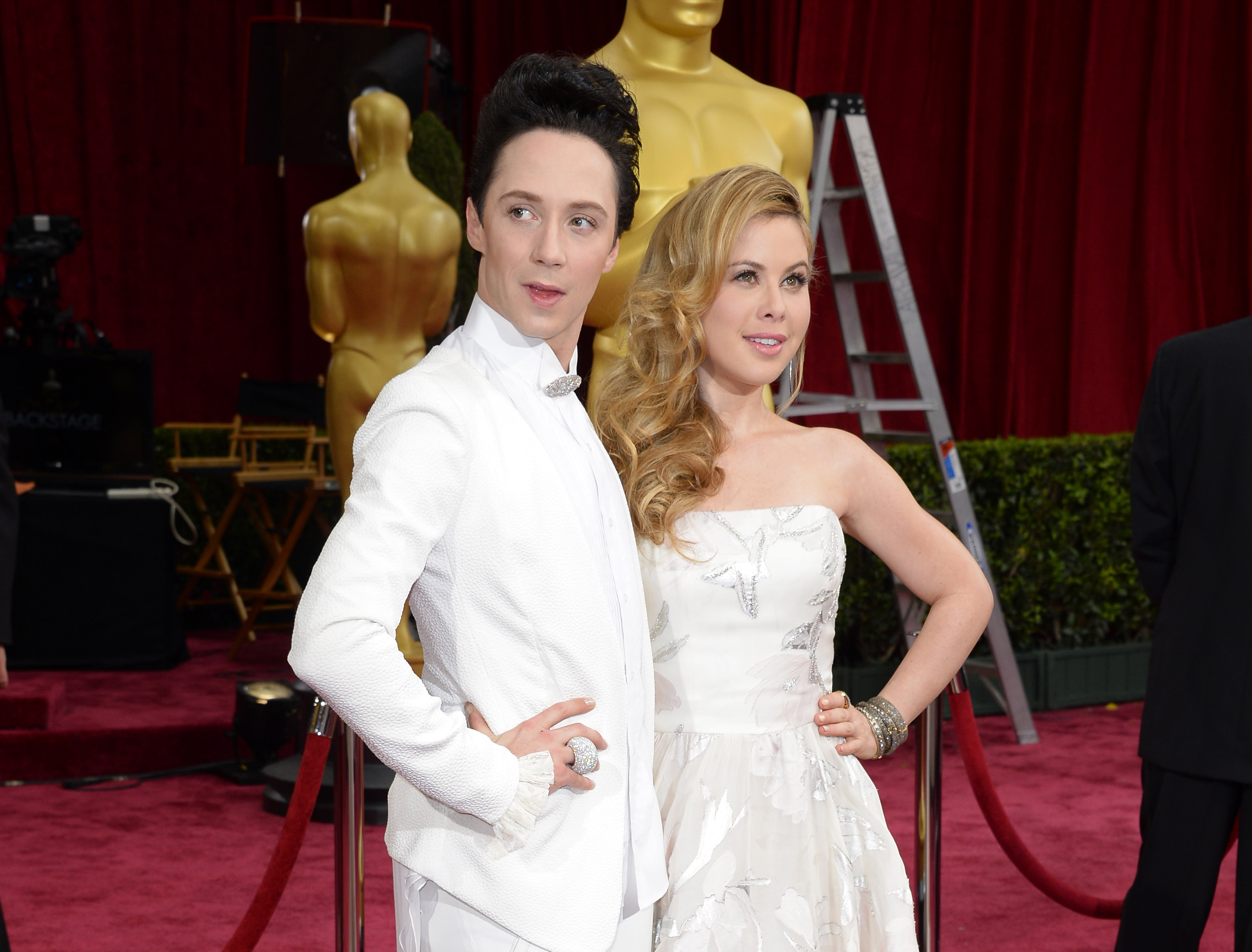 FILE - This March 2, 2014, file photo shows Johnny Weir, left, and Tara Lipinski at the Oscars in Los Angeles. Weir and Lipinski will serve as correspondents for NBCs coverage of the Rio de Janeiro Olympics. The network announced Monday, May 2, 2016, that