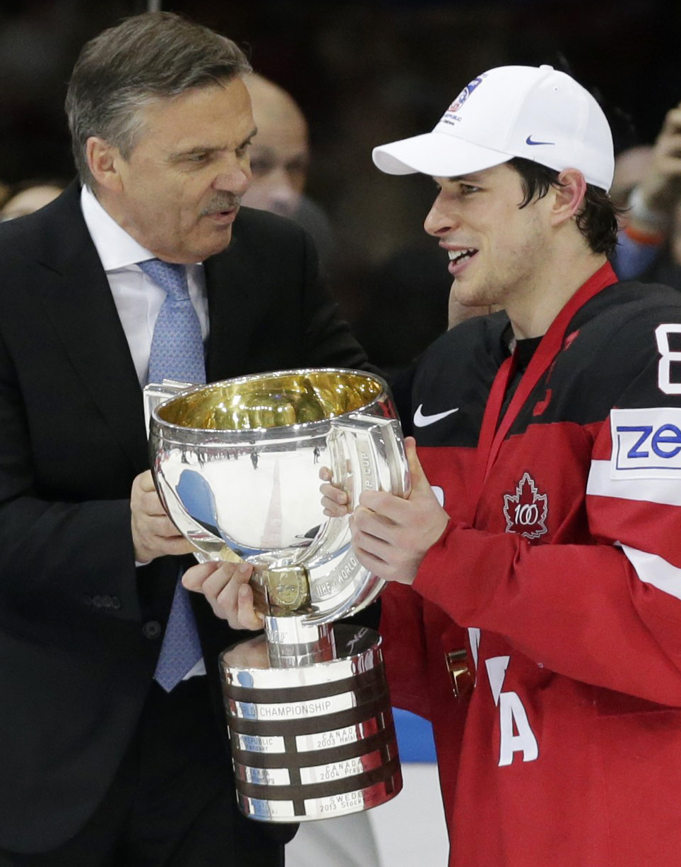 FILE - This is a Sunday, May 17, 2015 file photo of Canadas Sidney Crosby, right, as he receives a trophy from IIHF President Rene Fasel, left, after winning the Hockey World Championships in Prague, Czech Republic. NHL players will probably not compete a