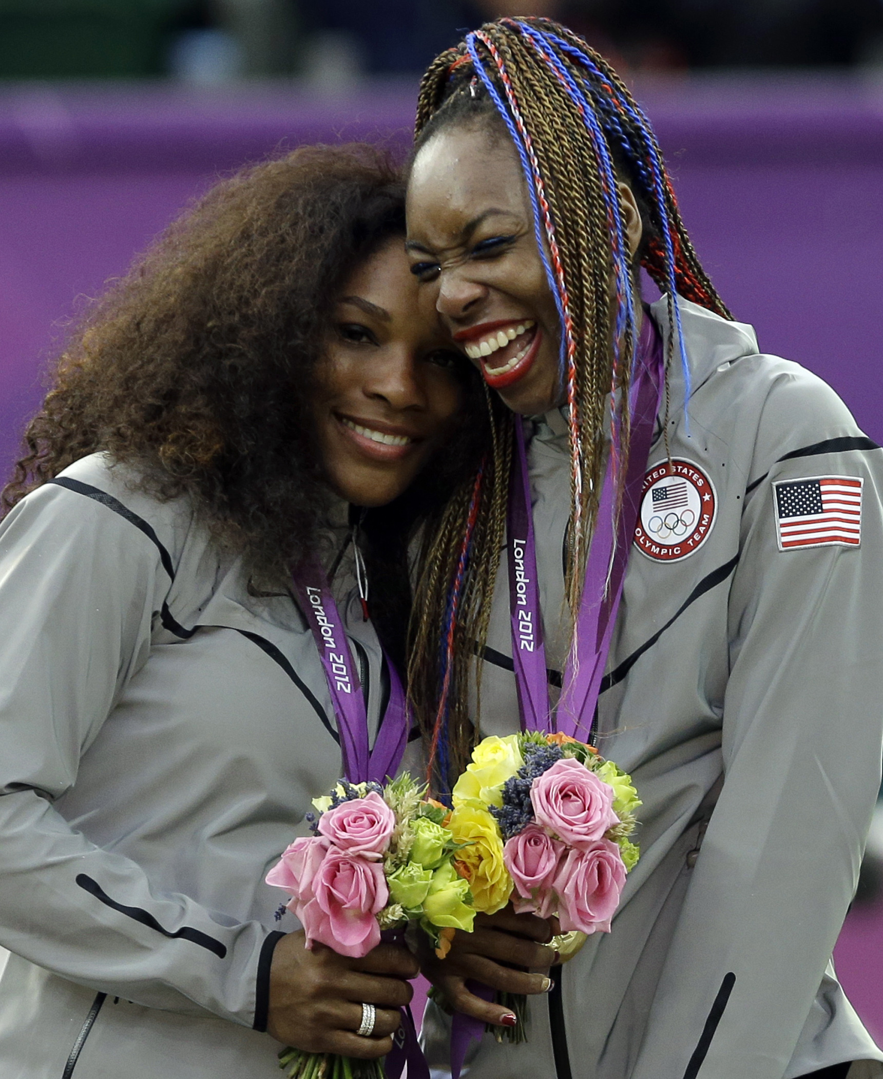 FILE -- In this file photo, taken on Aug. 5, 2012, at the London Summer Olympics, Serena Williams, left, and Venus Williams of the United States celebrate on podium after receiving their gold medals in women's doubles. The winningest team in Olympic tenni