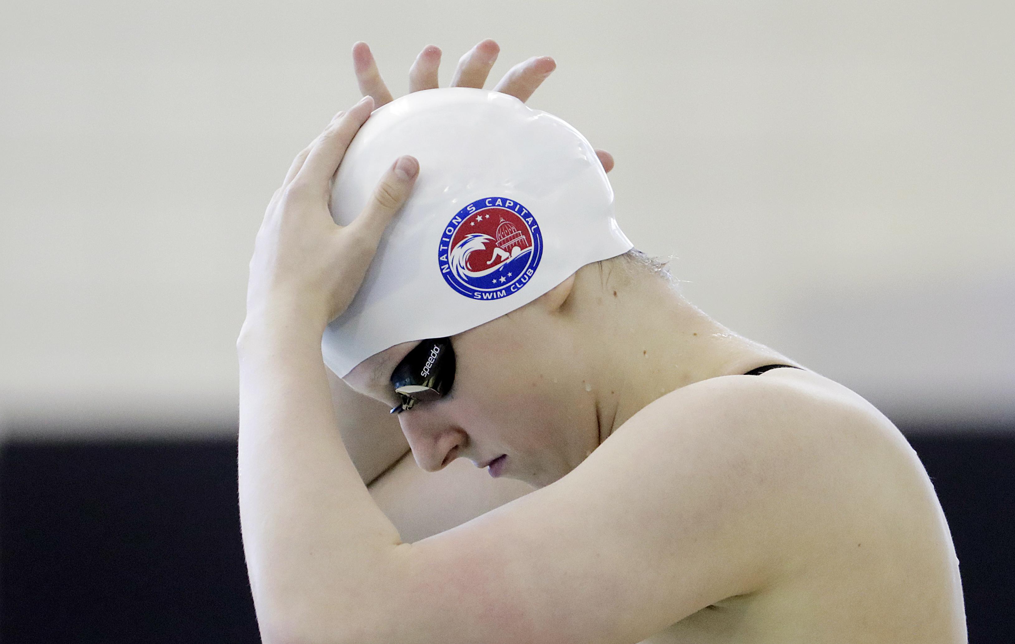 Katie Ledecky adjusts her swim cap before the start of the 400-meter freestyle at the Atlanta Classic swim meet Saturday, May 14, 2016, in Atlanta. (AP Photo/David Goldman)