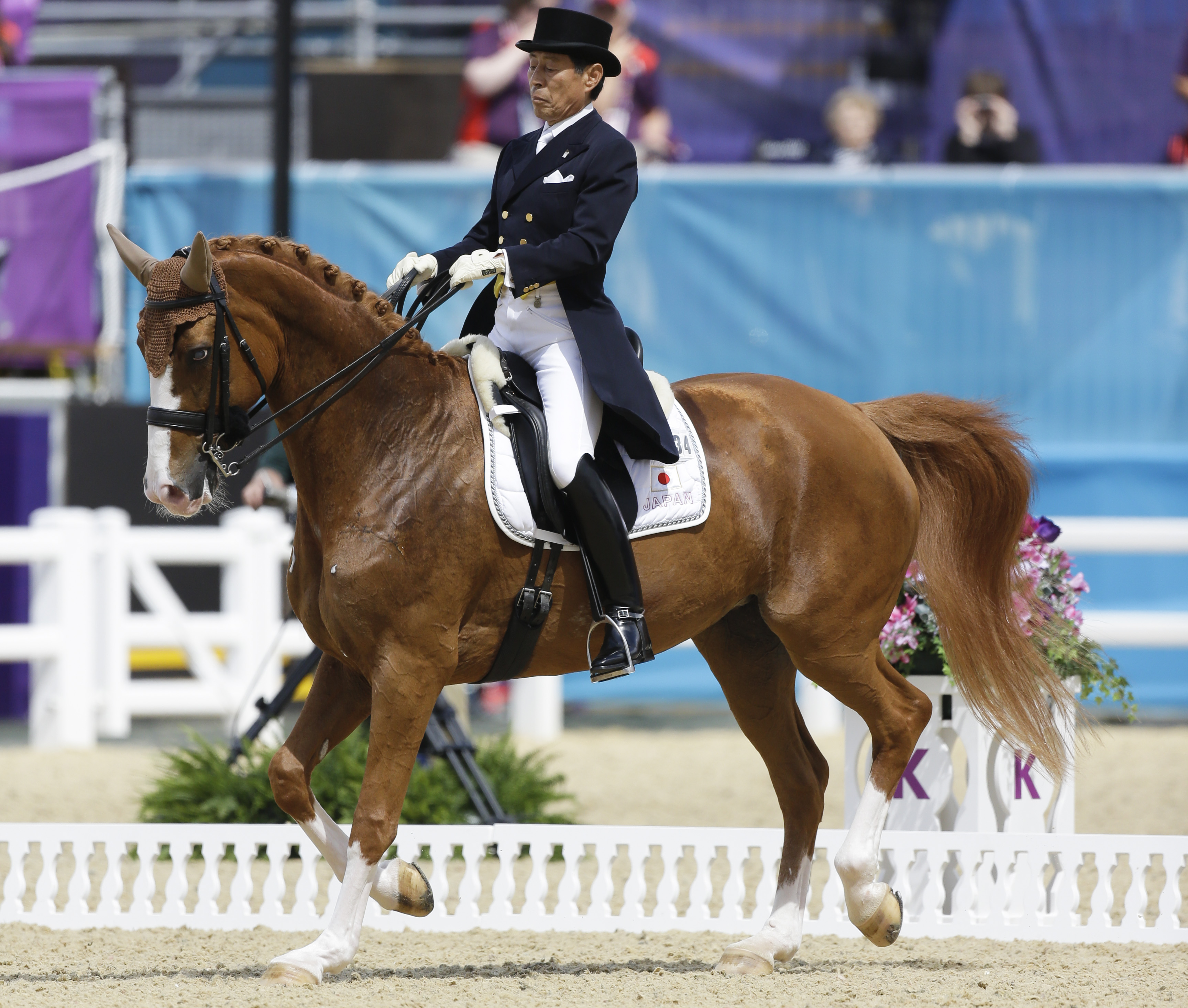 FILE - This is a Thursday, Aug. 2, 2012,  file photo of Hiroshi Hoketsu from Japan as he rides Whisper in the equestrian dressage competition, at the 2012 Summer Olympics in London.  Hiroshi Hoketsu a 75-year-old Japanese equestrian athlete will not be ab
