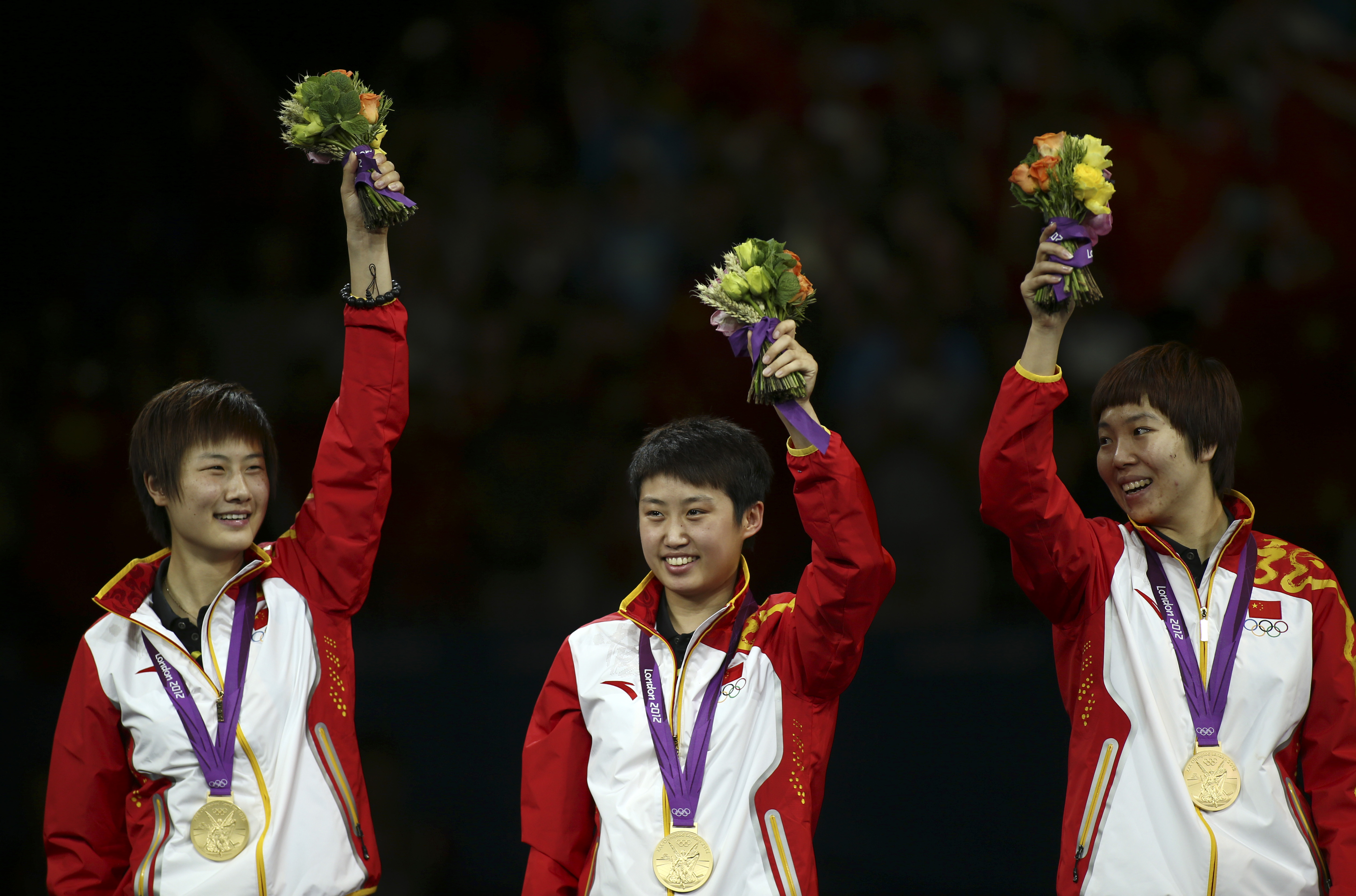 FILE - In this Aug. 7, 2012 file photo, China's Ding Ning, left, Guo Yue, center, and Li Xiaoxia, in a women's team table tennis gold medal match at the 2012 Summer Olympics, in London. Using a data-processing program to forcecast Olympic results, United
