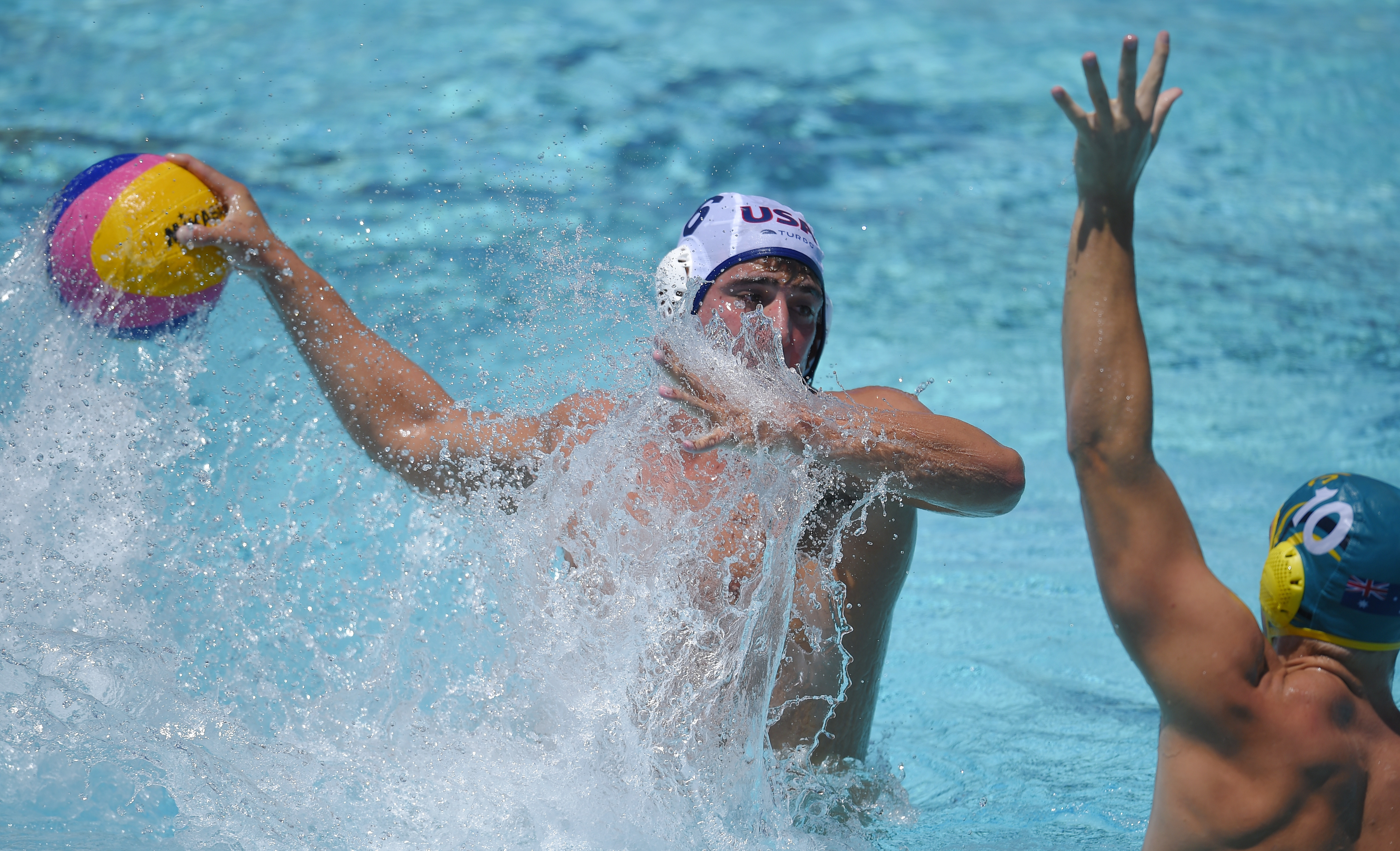 United States attacker Tony Azevedo, left, shoots and scores as Australia's Mitch Emery defends during a men's exhibition water polo match, Sunday, May 22, 2016, in Los Angeles. (AP Photo/Mark J. Terrill)