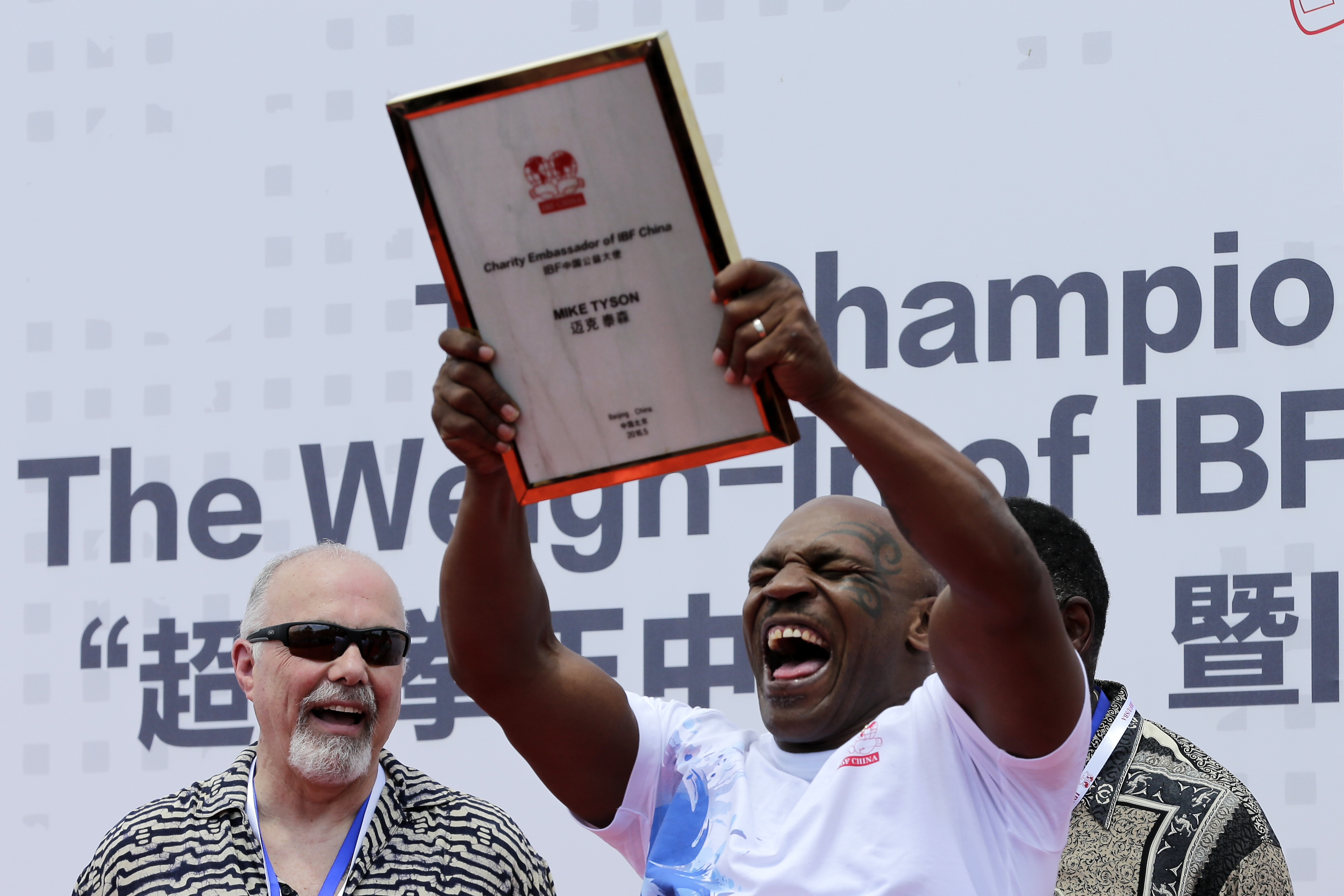Former heavyweight boxing champion Mike Tyson reacts as he is awarded the charity ambassador of IBF China during the weigh-in ceremony of the 2016 IBF World Championship Bout at the Mutianyu section of the Great Wall of China in Beijing, Tuesday, May 24,