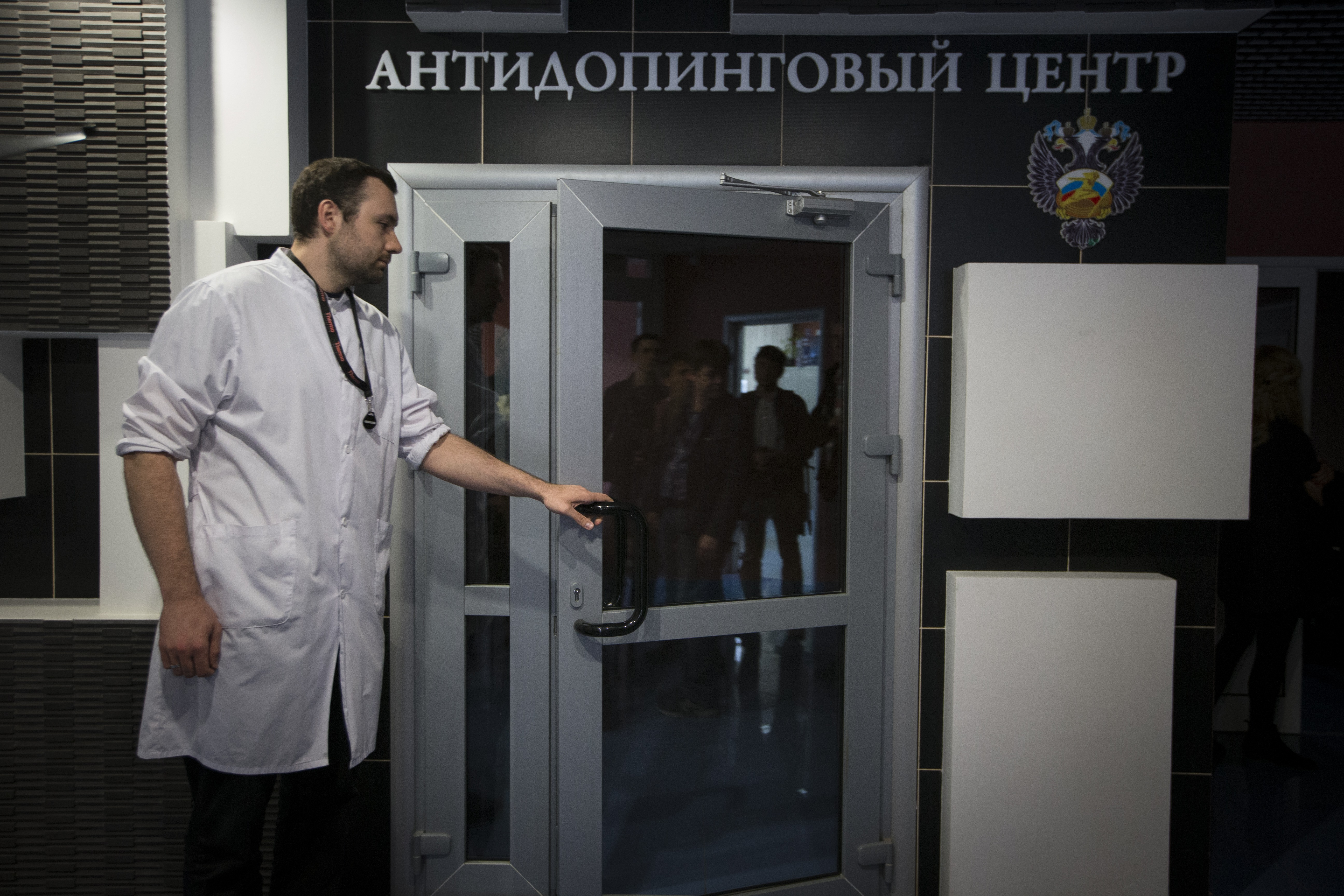 Grigory Dudko opens a door for journalists during his visit to Russia's national drug-testing laboratory  in Moscow, Russia, Tuesday, May 24, 2016. The Russians have been accused of state-sponsored doping at the 2014 Sochi Olympics, and the IOC has asked