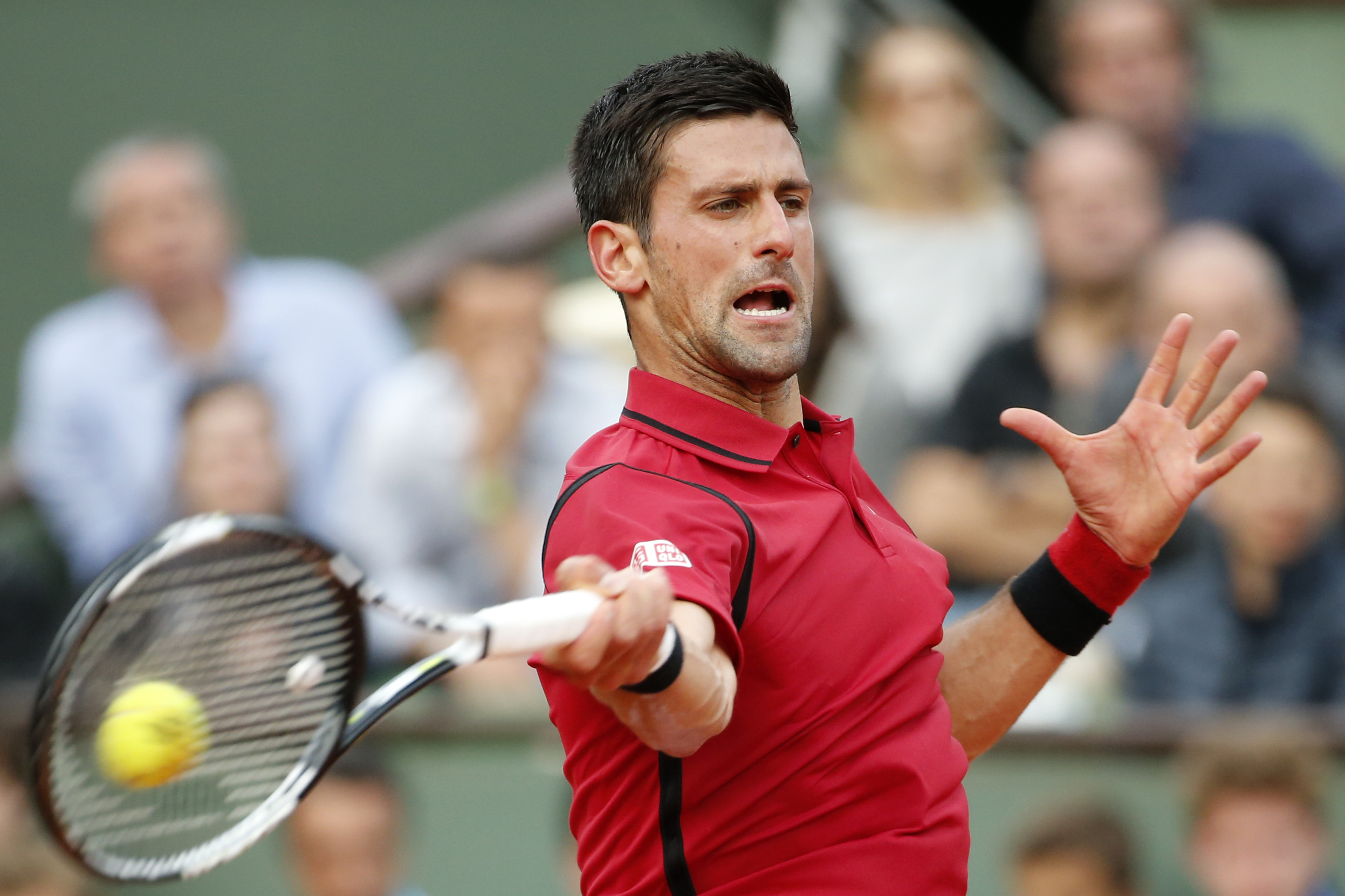 Serbia's Novak Djokovic returns in the third round match of the French Open tennis tournament against Britains Aljaz Bedene at the Roland Garros stadium in Paris, France, Saturday, May 28, 2016. (AP Photo/Alastair Grant)